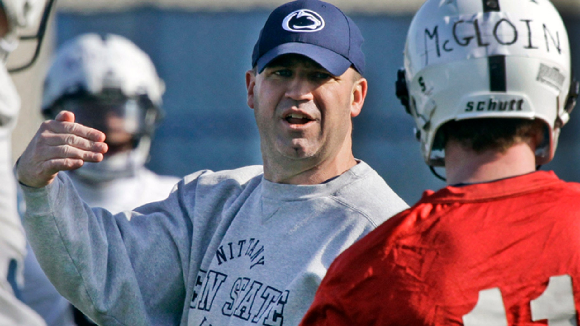 FILE - In this March 26, 2012, file photo, Penn State football coach Bill O' Brien, left, gives instruction to quarterback Matt McGloin (11) during the first day of spring NCAA college football practice in State College, Pa.