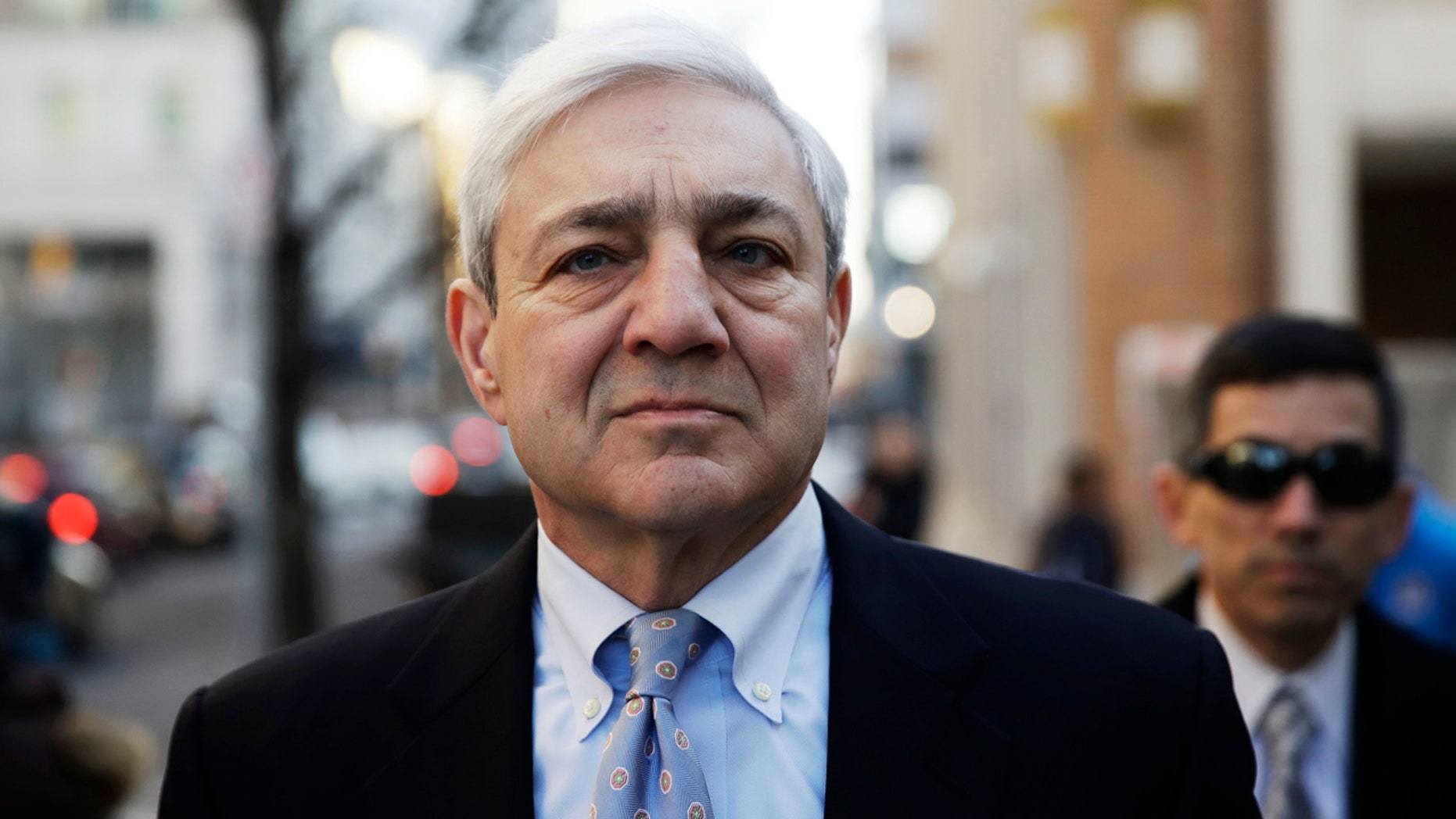 Former Penn State president Graham Spanier walks to the Dauphin County Courthouse in Harrisburg, Pa., Monday, March 20, 2017.