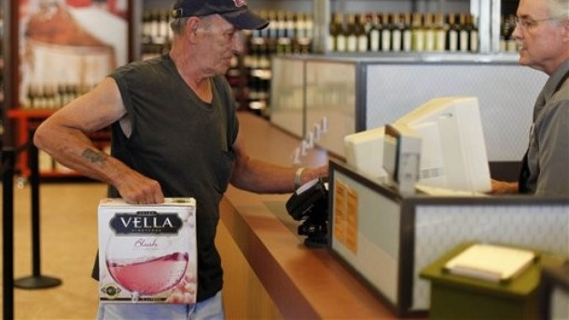 In this Thursday, July 22, 2010 photo, George Slack, left, of Lambertville N.J. makes the first purchase at a newly opened state wine and liquor store in New Hope Pa.
