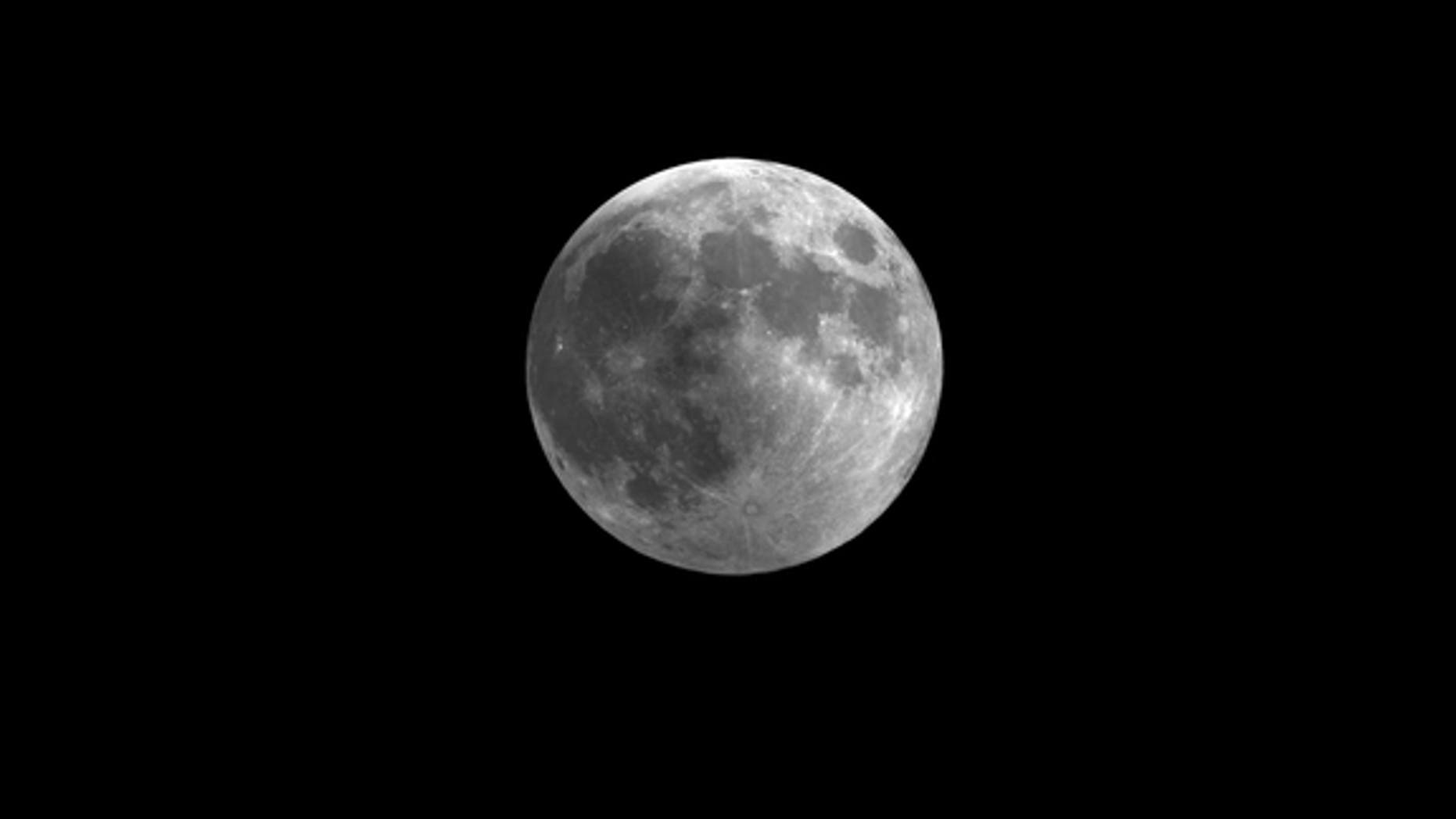 This still from a video skywatching guide shows how the penumbral lunar eclipse of Nov. 28 will slightly darken the full moon. The video guide is a monthly resource by the Space Telescope Science Institute in Maryland.