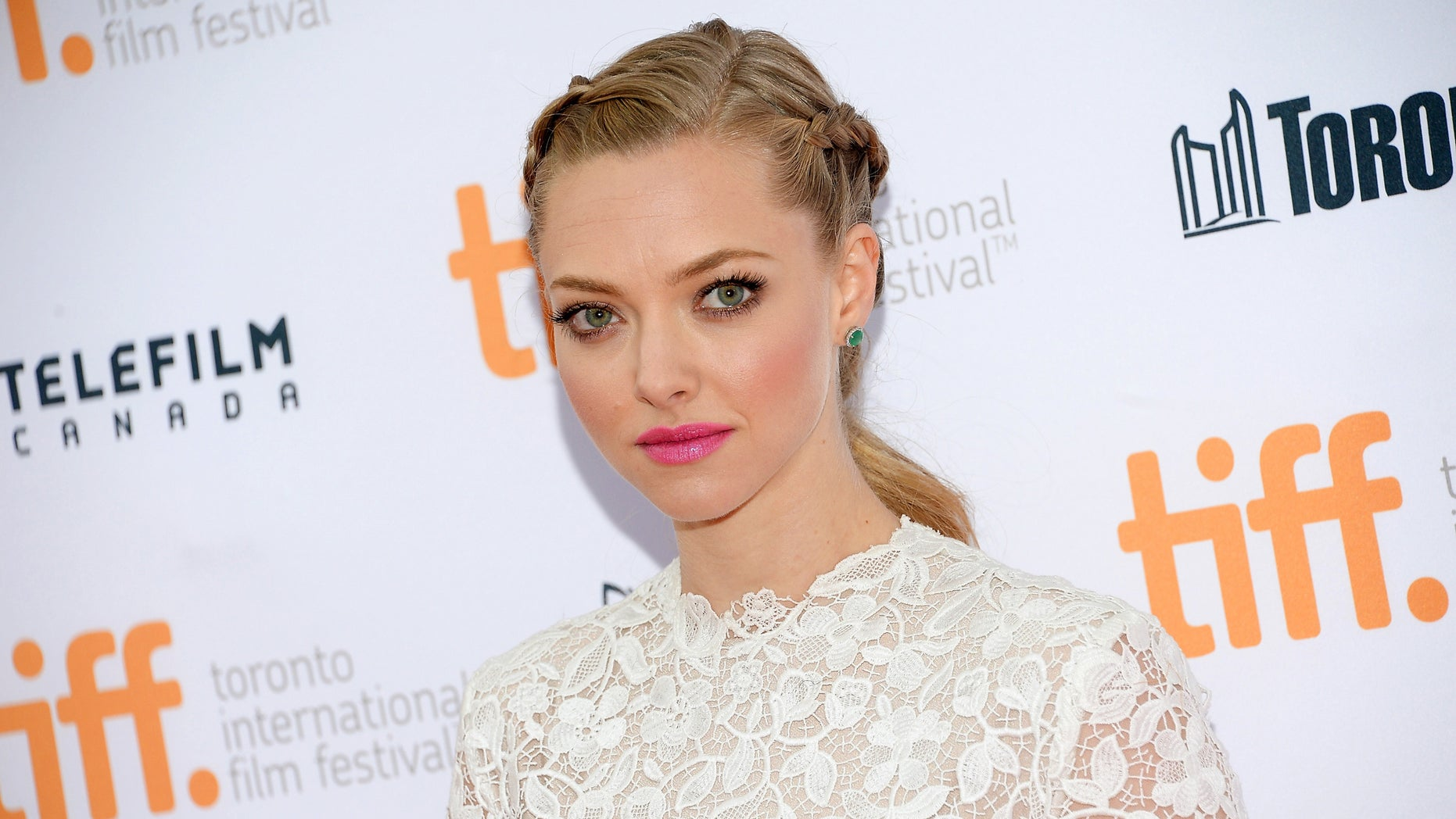 """In this Sept. 6, 2014 file photo, actress Amanda Seyfried attends the """"While We're Young"""" premiere during the Toronto International Film Festival in Toronto."""