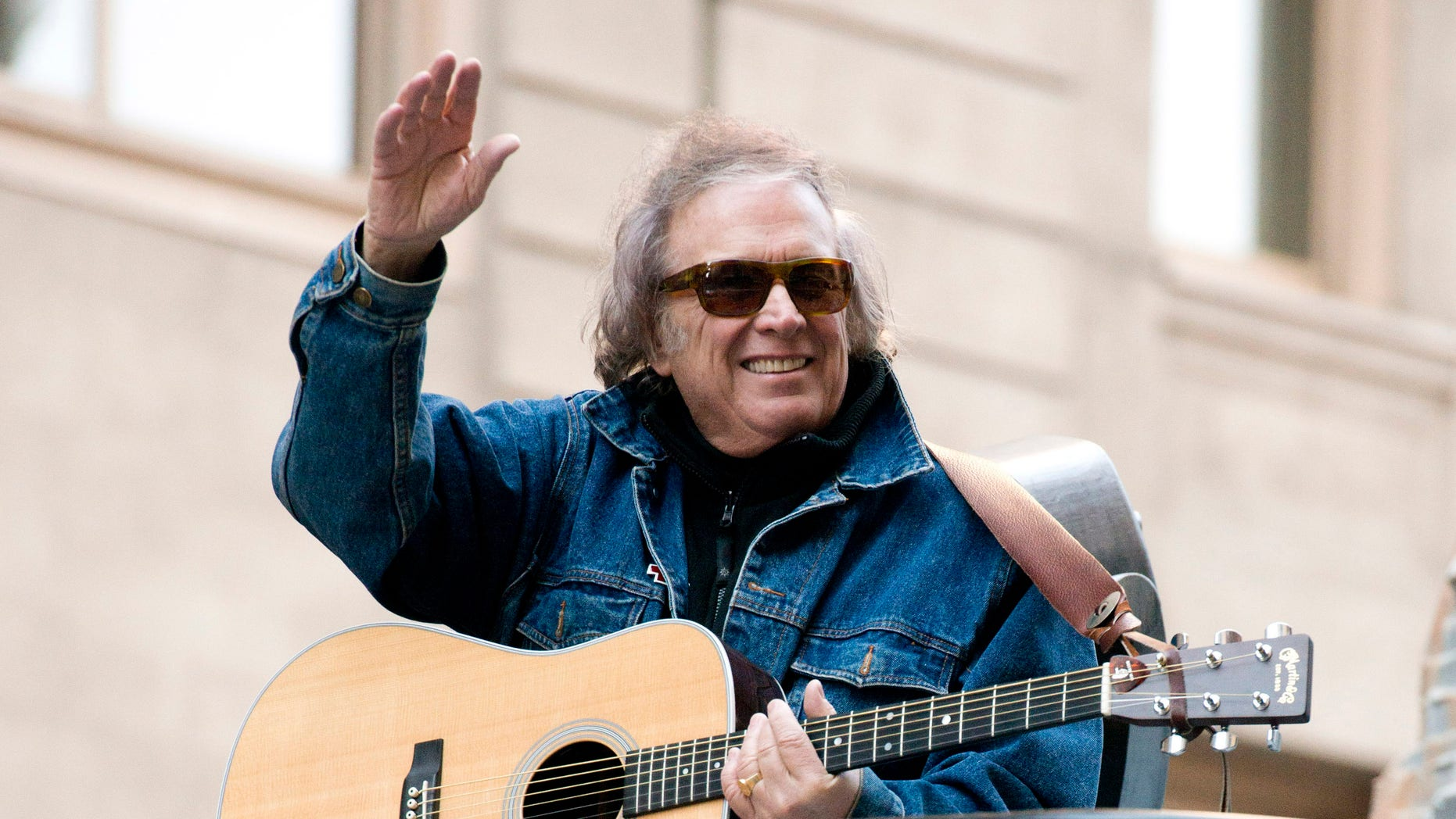 """FILE - In this Nov. 22, 2012 file photo, Don McLean rides a float in the Macy's Thanksgiving Day Parade in New York. McLean and his wife have finalized their divorce and agreed to a $10 million settlement.A spokesman for McLean said Monday, June 20, 2016, that the singer """"chose to ignore a premarital agreement"""" and provide the settlement.  (AP Photo/Charles Sykes, File)"""