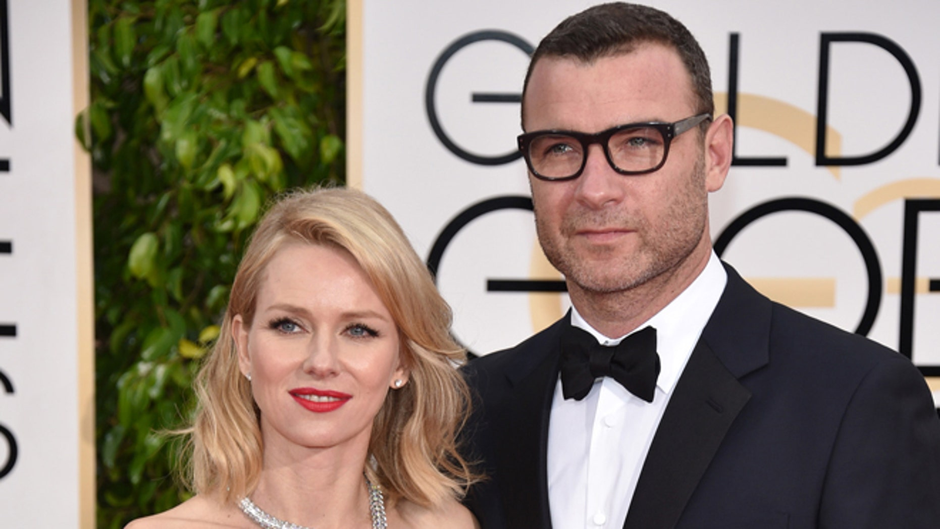 In this Jan. 11, 2015 file photo, Naomi Watts, left, and Liev Schreiber arrive at the 72nd annual Golden Globe Awards in Beverly Hills, Calif.