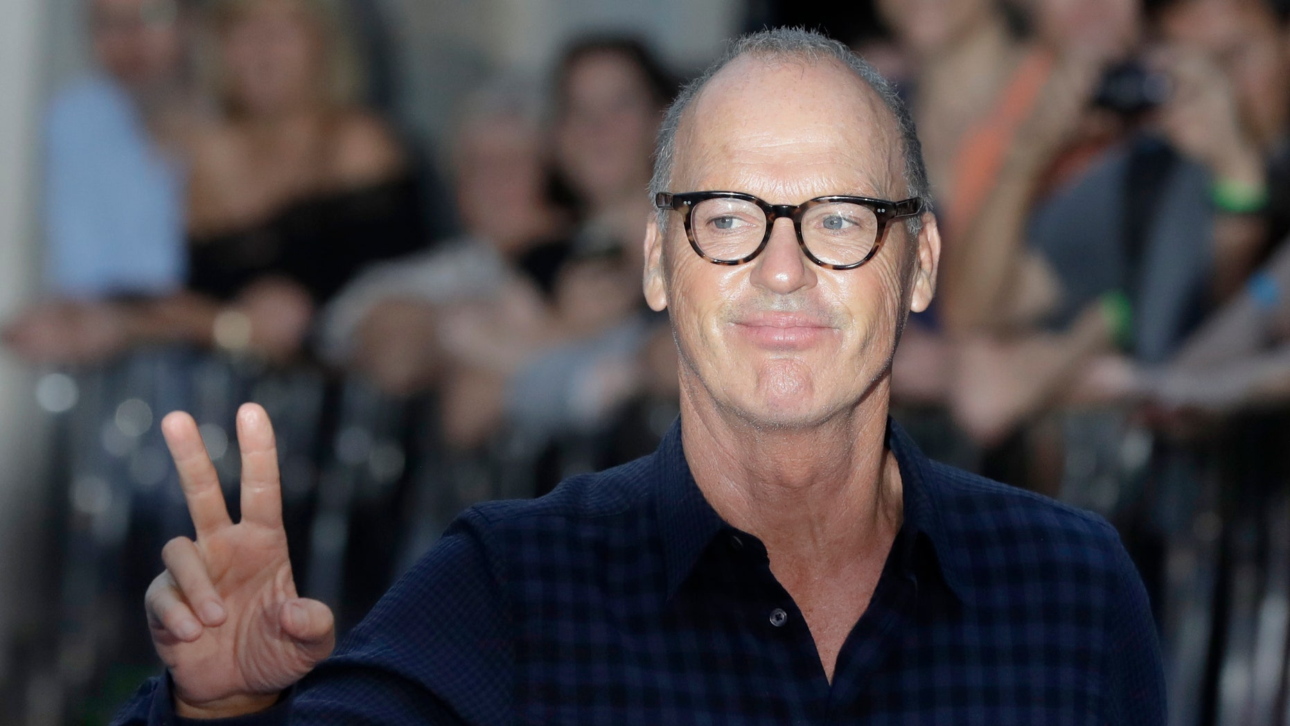 In this Sept. 15, 2016, file photo, actor Michael Keaton poses for photographers upon arrival at the world premiere of the film 'The Beatles, Eight Days a Week' in London.
