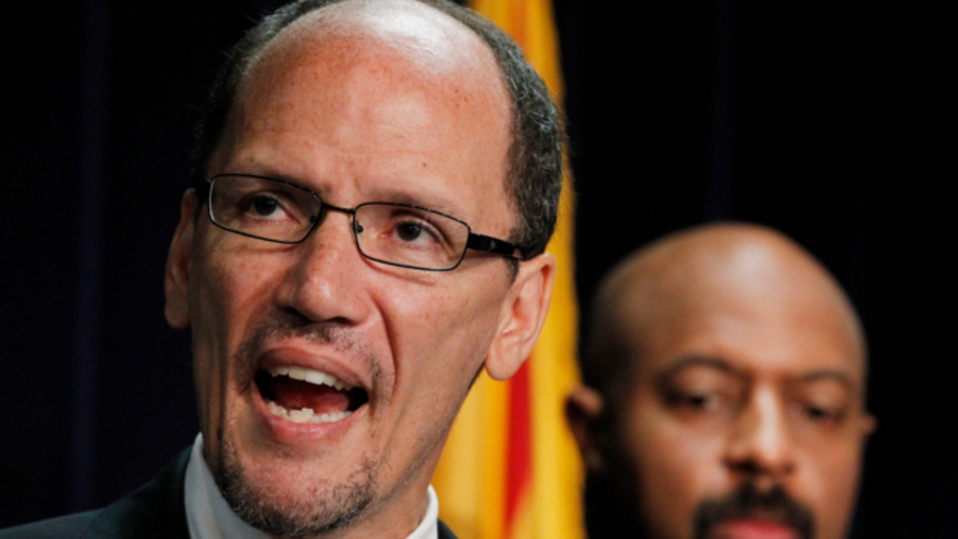 May 10, 2012: United States Assistant Attorney General Thomas Perez, left, is joined by Deputy Assistant Attorney General for Civil Rights, Roy Austin, during a news conference in Phoenix.