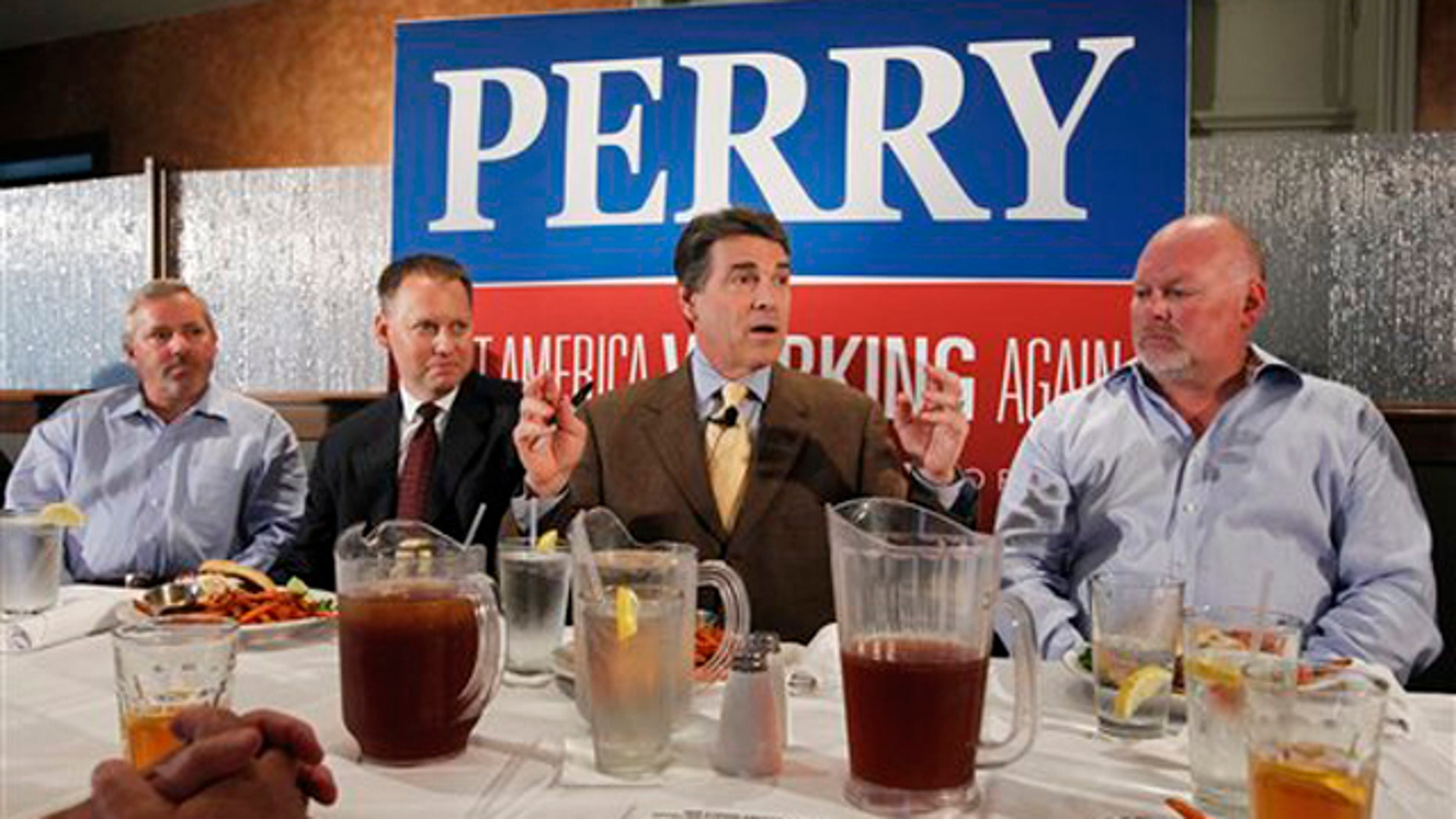 Texas Gov. Rick Perry meets with business leaders at a lunch in Dubuque, Iowa, Aug. 16.