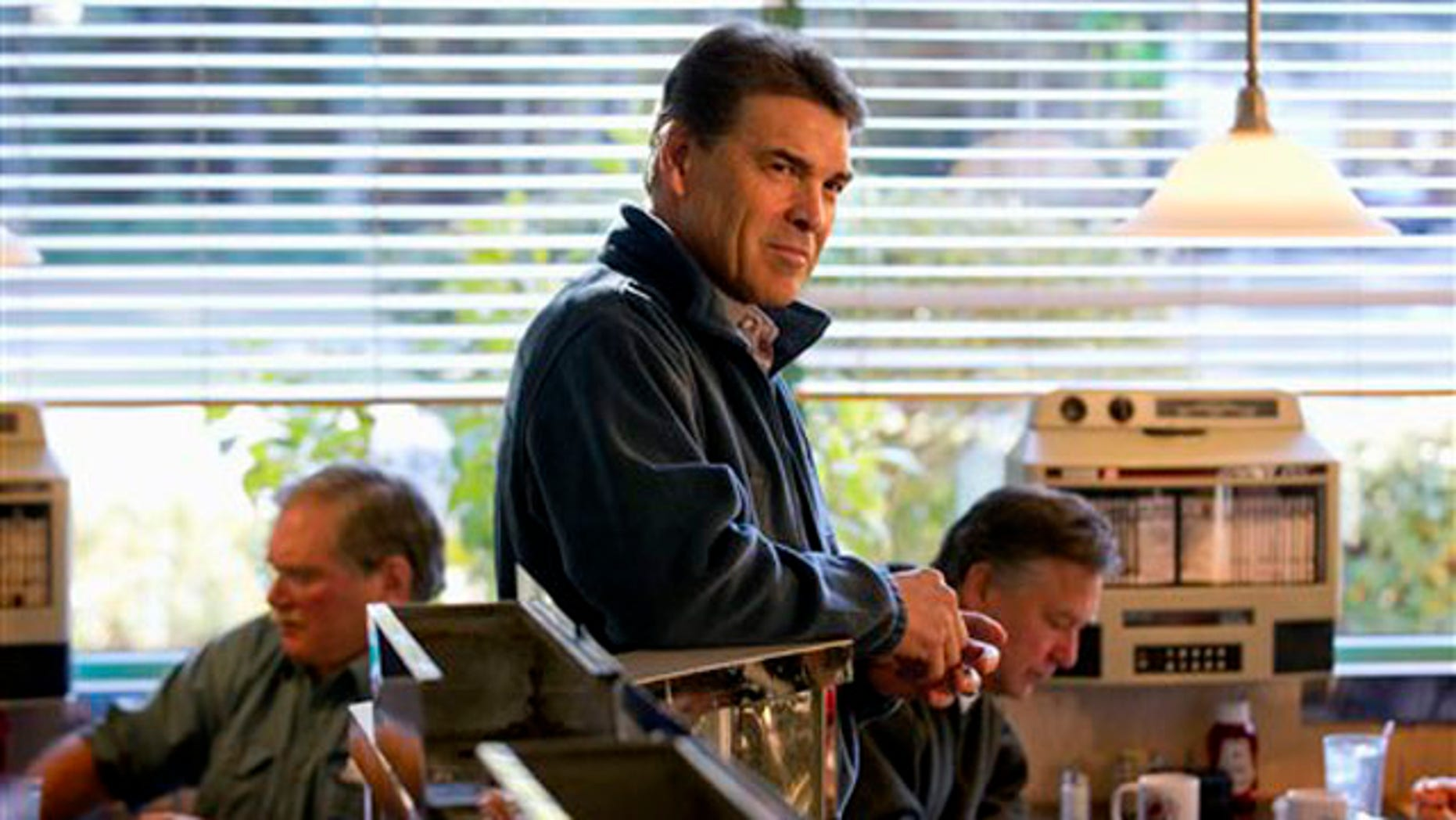 Jan. 13, 2012: Rick Perry waits to be introduced at a campaign stop at the Hilton Head Diner in Hilton Head, S.C.