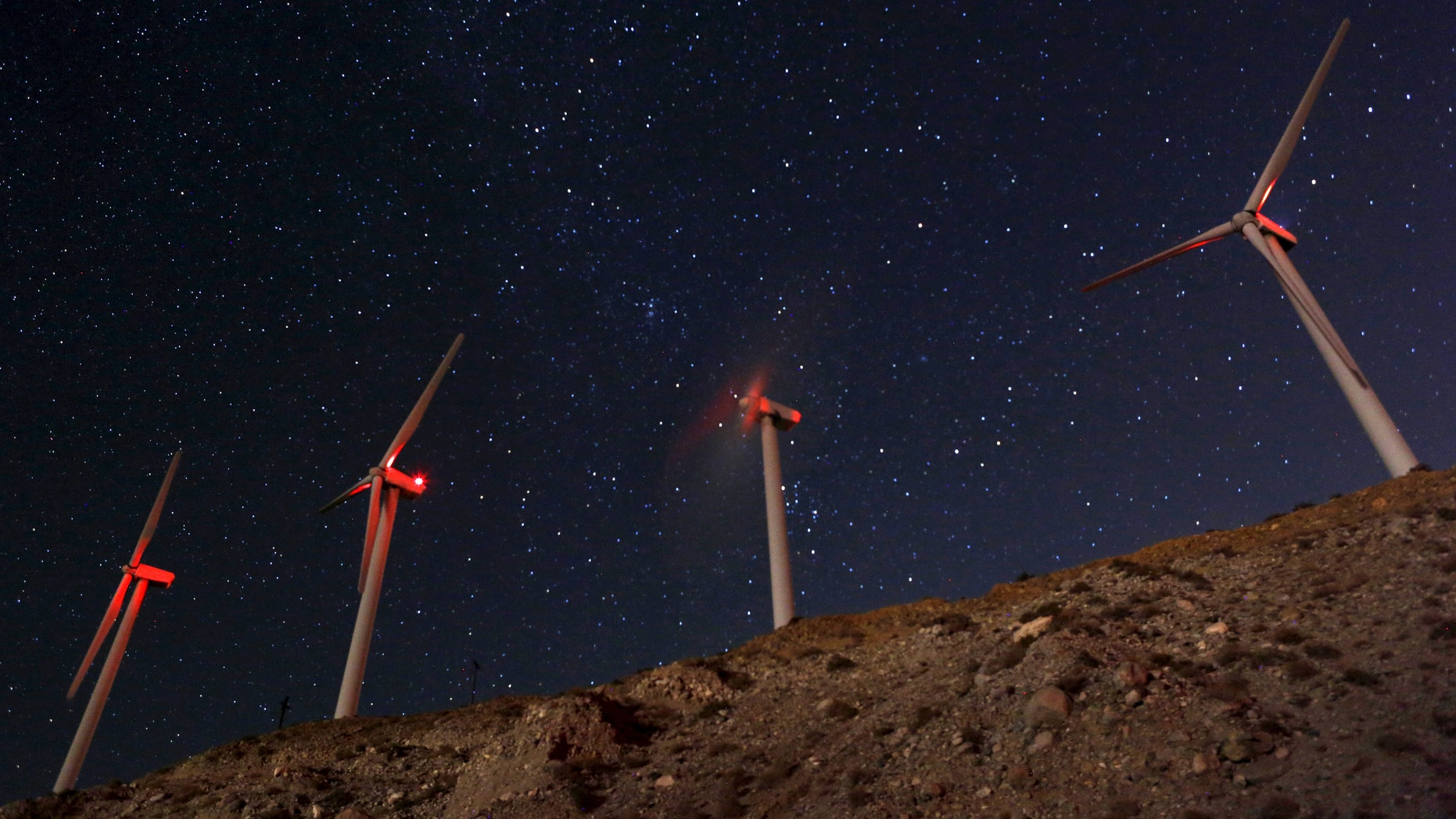 A meteor (top L) speeds past windmills at the San Gregornio Pass Wind Farm near Whitewater, Calif., Aug. 13, 2015 during the annual Perseid meteor shower. (REUTERS/Sam Mircovich)
