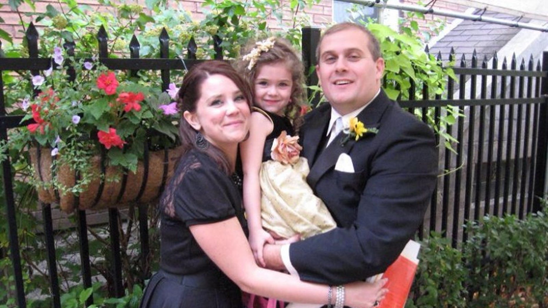 Amee and Chris Banks pose with their daughter, Persephonee, who died Thursday of a rare strep infection.