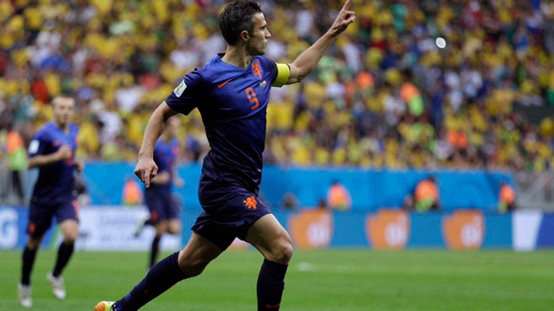 July 12, 2014: Netherlands' Robin van Persie celebrates after scoring his team's first goal on a penalty shot during the World Cup third-place soccer match between Brazil and the Netherlands at the Estadio Nacional in Brasilia, Brazil, Saturday, July 12, 2014. (AP)