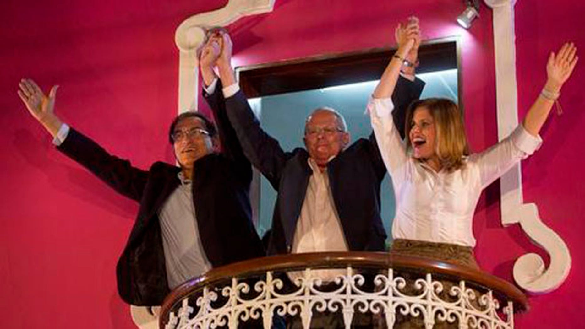 FILE - In this June 5, 2016 file photo, presidential candidate Pedro Pablo Kuczynski, center, celebrates with his running mates for first and second vice-presidents Martin Vizcarra, left, and Mercedes Araoz, right, from the balcony of their headquarters in Lima, Peru. Kuczynski began the task of forming a government Friday, June 10, 2016, after his rival Keiko Fujimori conceded defeat in Peru's closest presidential contest in five decades. His margin of victory was less than 43,000 votes, or 0.2 percentage points. (AP Photo/Rodrigo Abd, File)