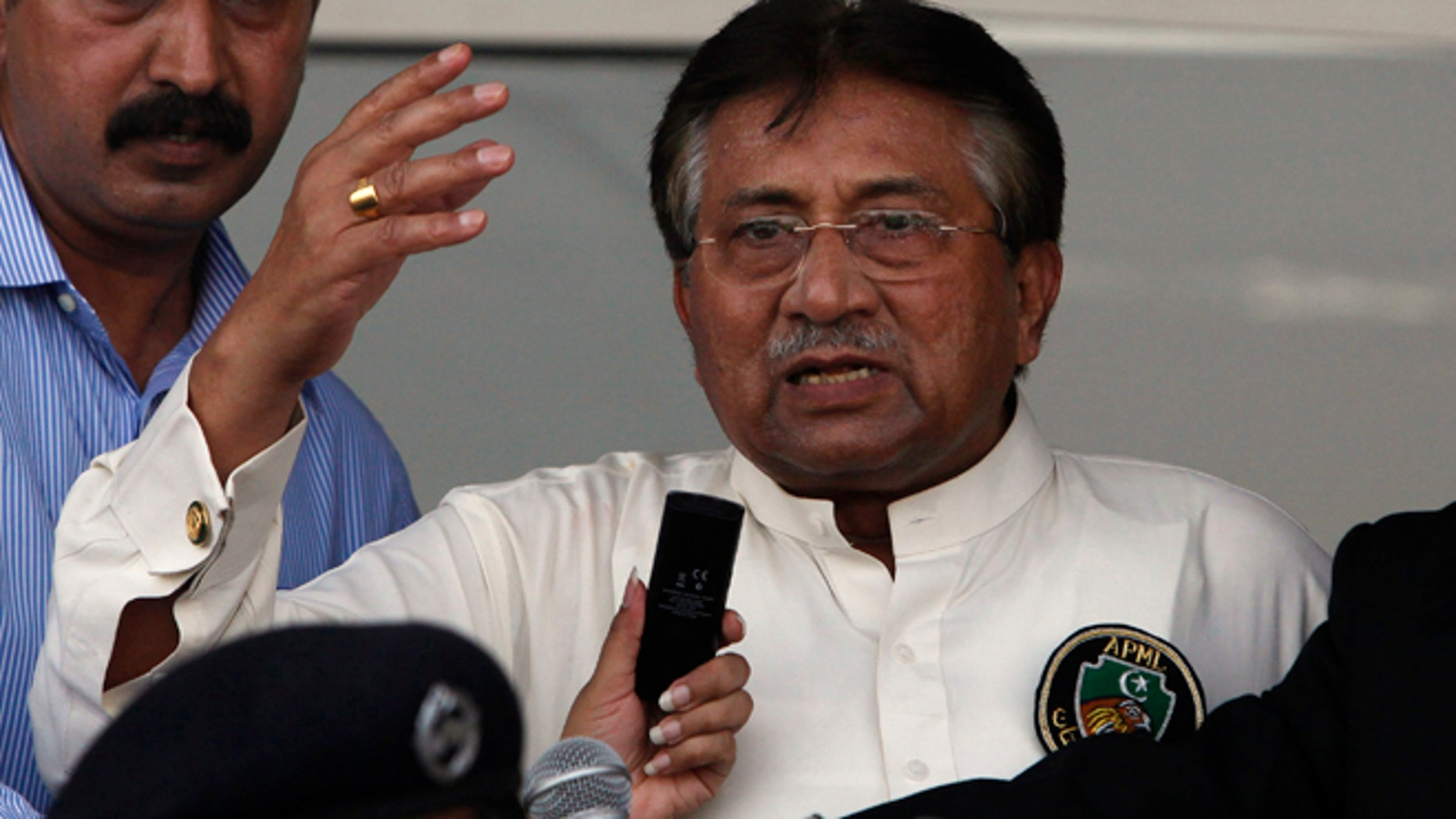 Former president, Pervez Musharraf, recently arrives at an airport in Karachi. Pakistan's former leader admits his regime had a secret pact to allow drone strikes in the country.