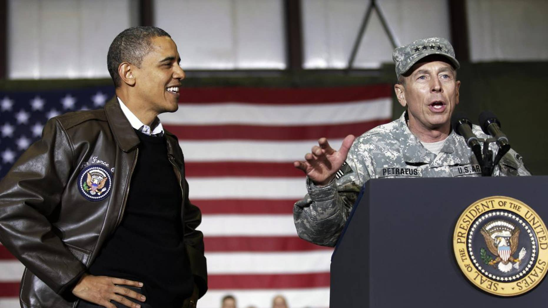 President Barack Obama, left, is introduced NATO Commander in Afghanistan U.S. Gen David Petraeus, right, to the troops during a rally in an unannounced visit at Bagram Air Field in Afghanistan, Friday, Dec. 3, 2010.(AP Photo/Pablo Martinez Monsivais)