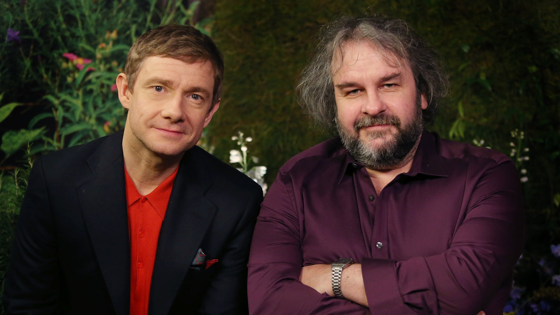 "Monday, Dec. 1, 2014. Actor Martin Freeman and director Peter Jackson from New Zealand poses for photographs in promotion for the film ""The Hobbit, Battle of the Five Armies"" in the Claridges suite in west London."
