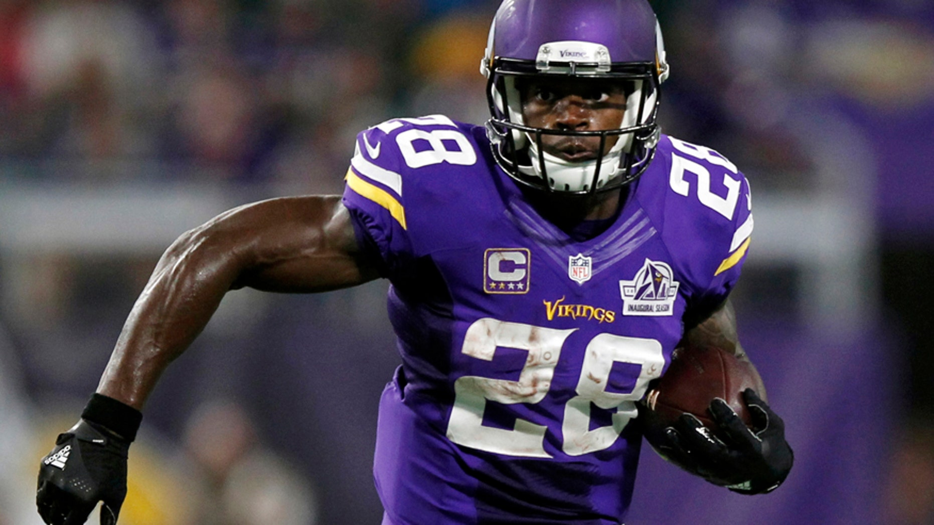 Sept. 18, 2016: Minnesota Vikings running back Adrian Peterson carries the ball during the first half of an NFL football game against the Green Bay Packers in Minneapolis