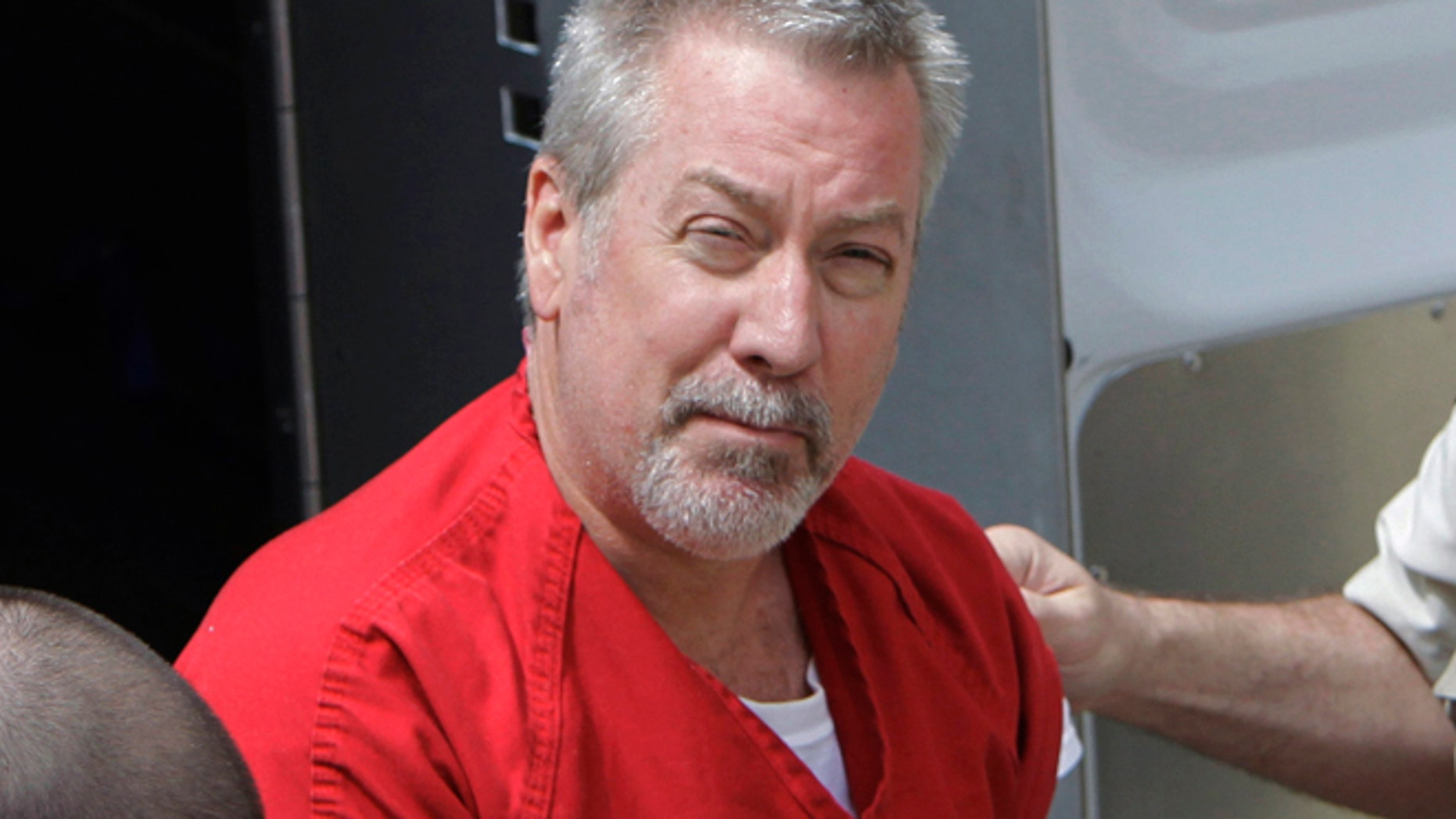FILE - In this May 8, 2009 file photo, former Bolingbrook, Ill., police officer Drew Peterson arrives for court in Joliet, Ill. Jury selection is set to begin Friday, May 20, 2016, in Chester, Ill., in the murder-for-hire trial of Peterson, who is accused of plotting to kill the prosecutor who put him behind bars in his third wife's death.