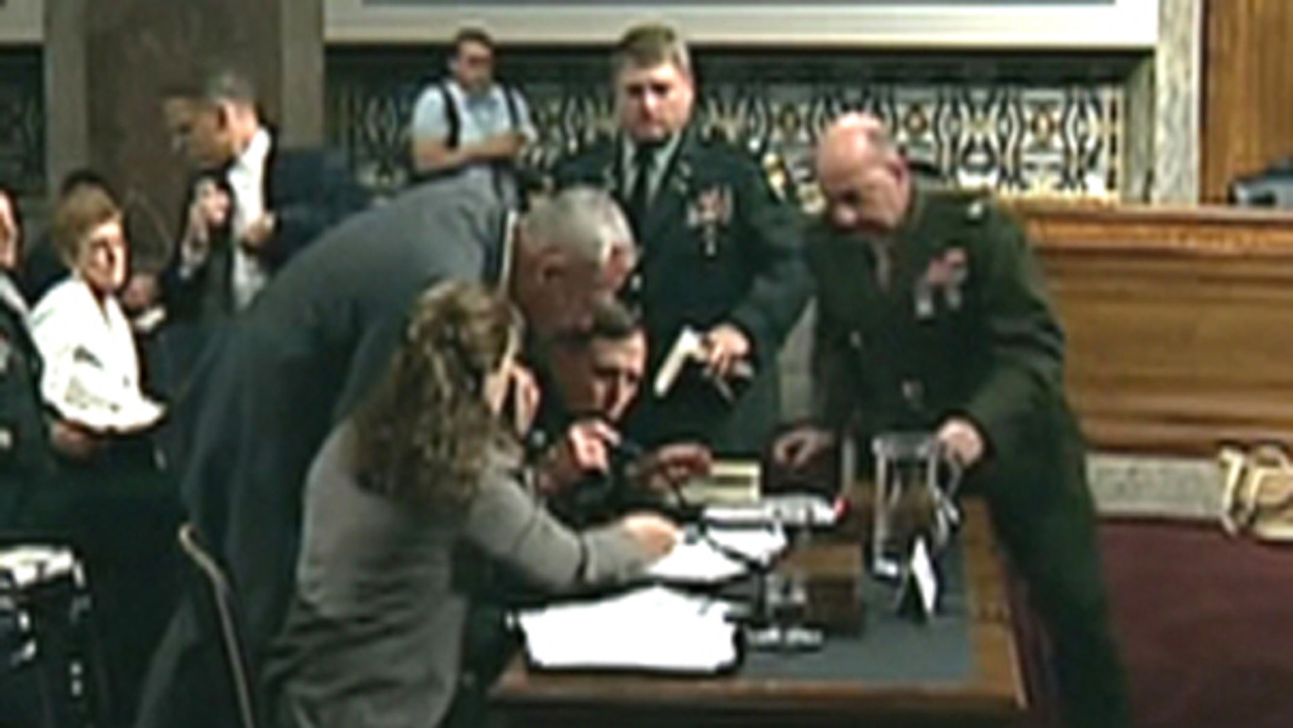 Gen. David Petraeus can be seen slumping over a table during testimony before a Senate panel on June 15 in Washington. (FNC)
