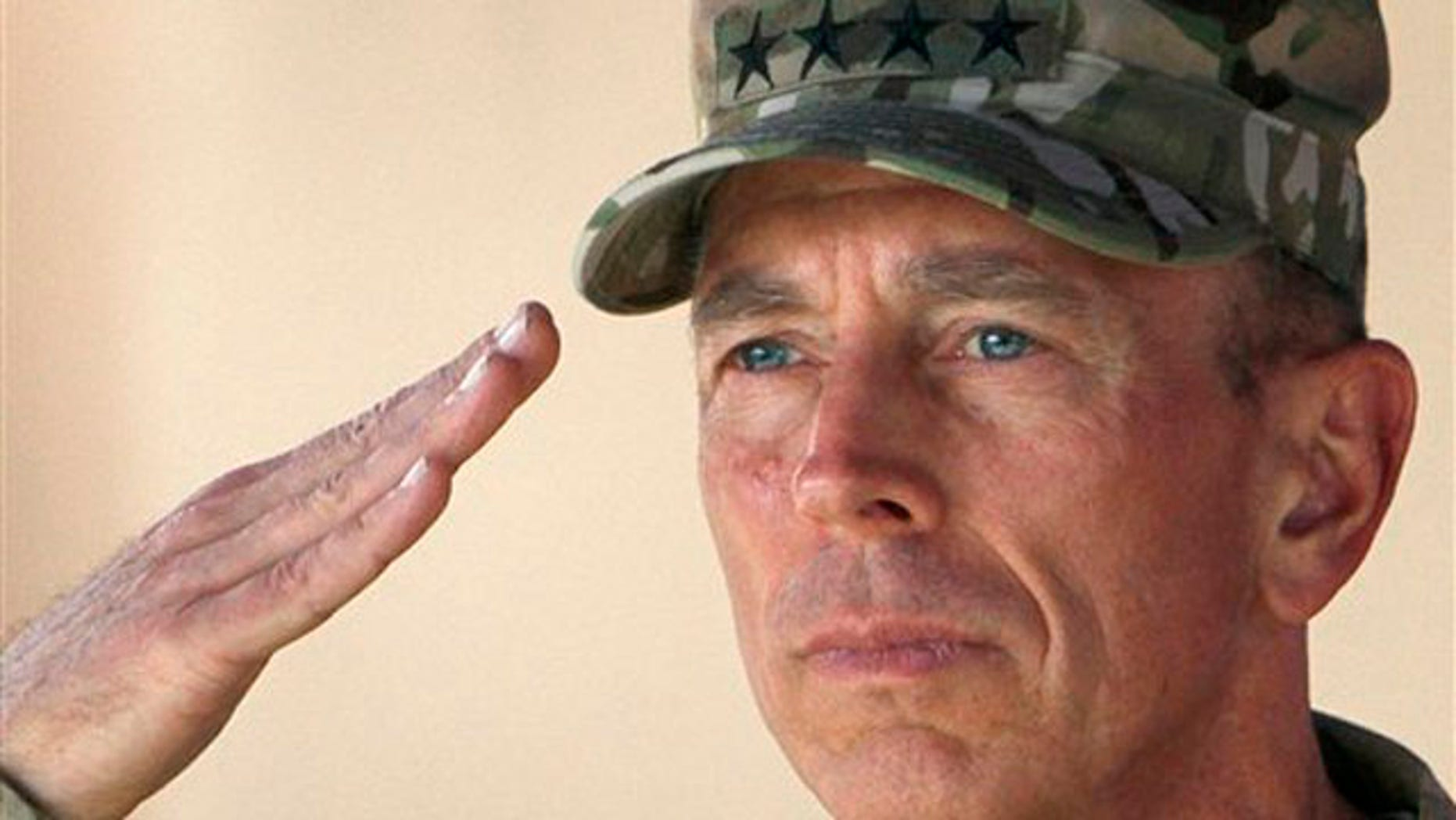 In this July 18 file photo, Gen. David Petraeus salutes during a changing of command ceremony in Kabul, Afghanistan.
