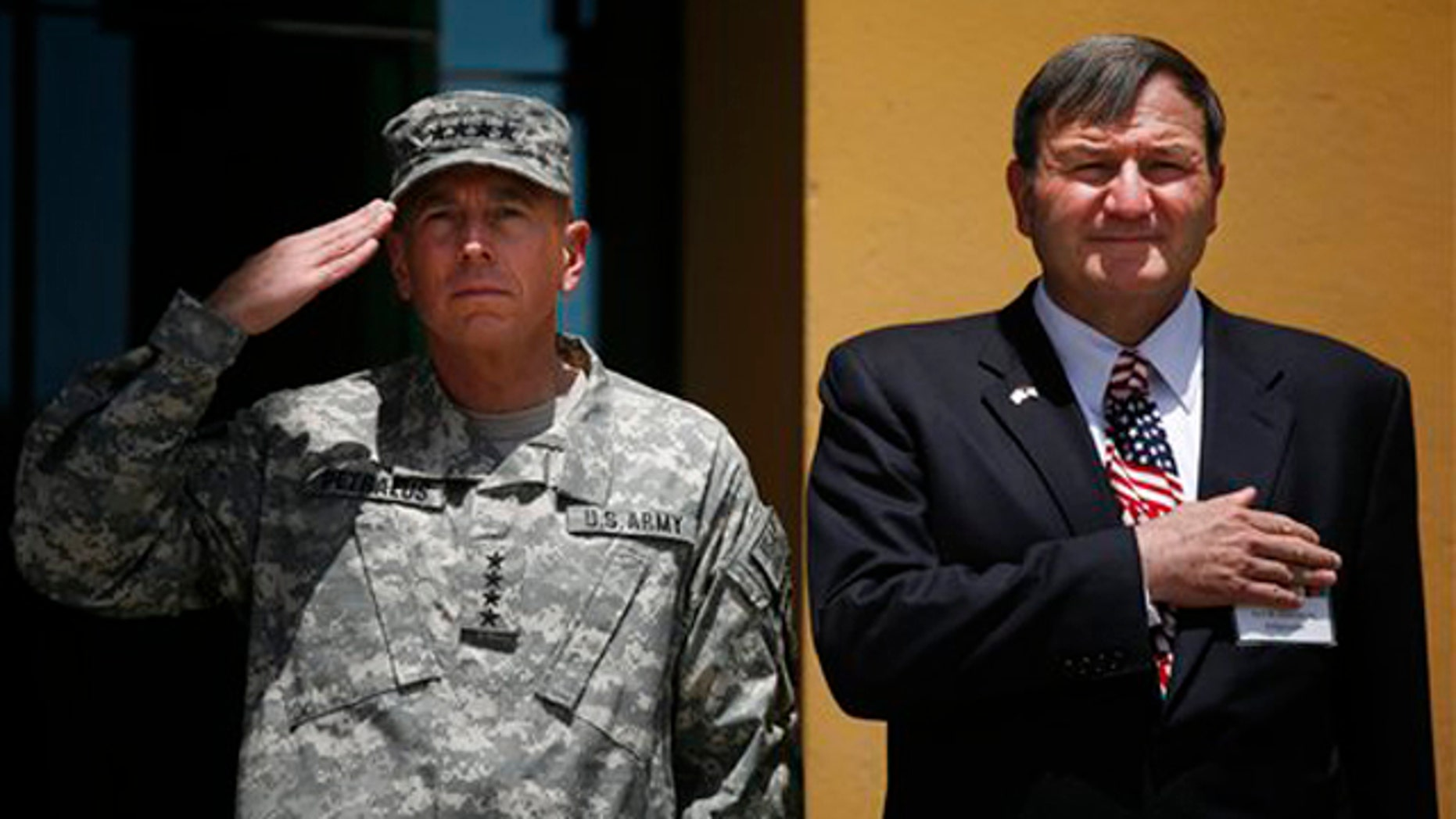 Gen. David Petraeus and U.S. Ambassador to Afghanistan Karl Eikenberry salute during the Independence Day celebrations July 3 in Kabul. (AP Photo)