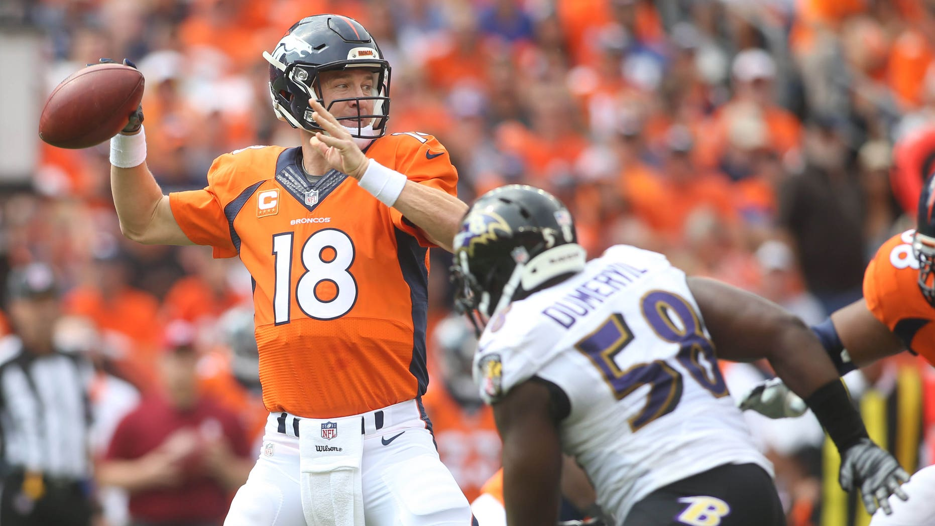 Sep 13, 2015; Denver, CO, USA; Denver Broncos quarterback Peyton Manning (18) throws the ball during the first half against the Baltimore Ravens at Sports Authority Field at Mile High. Mandatory Credit: Chris Humphreys-USA TODAY Sports