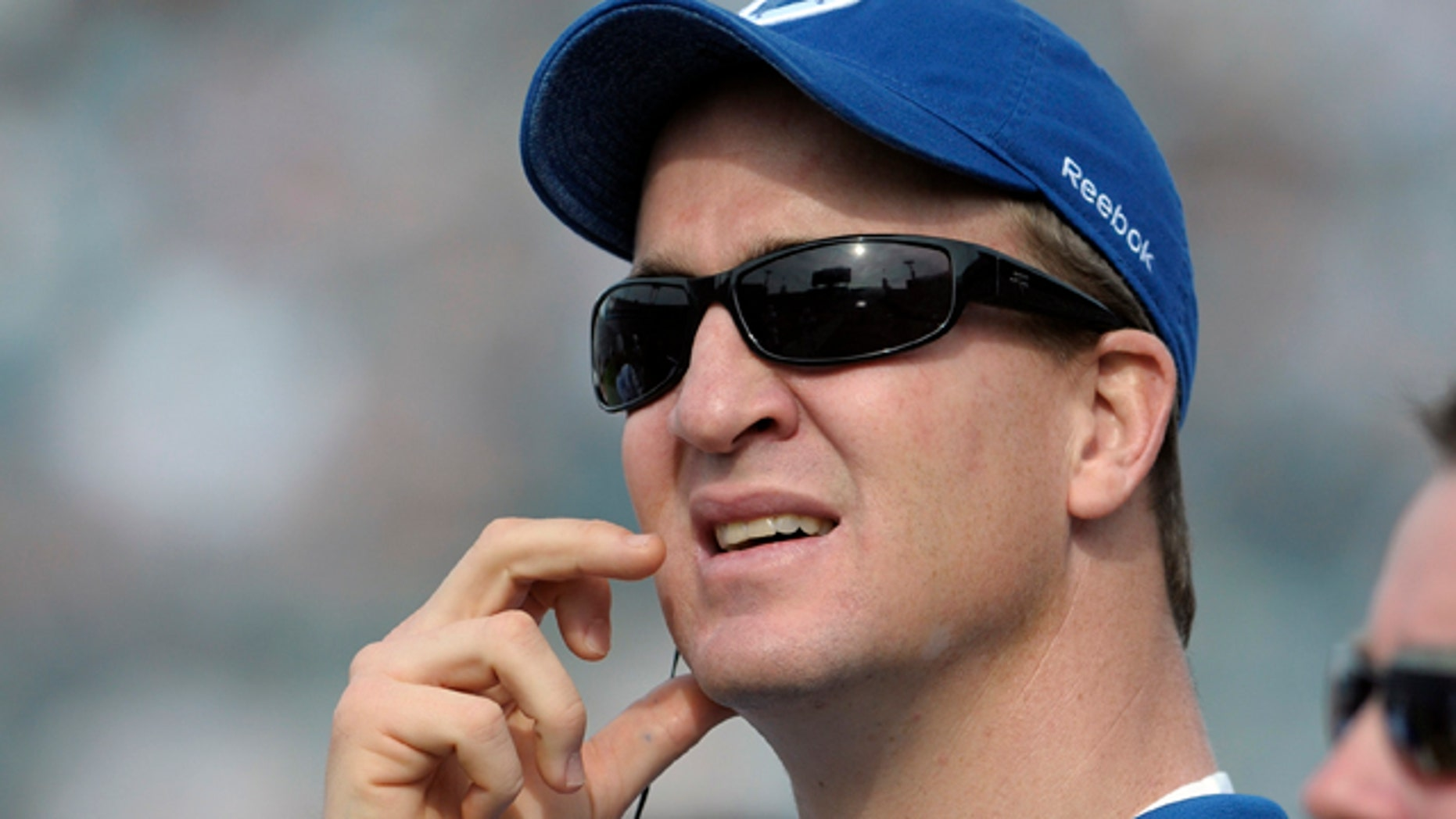 Jan. 1, 2012: FILE - In this file photo, Indianapolis Colts quarterback Peyton Manning watches from the sideline during the first half of an NFL football game against the Jacksonville Jaguars in Jacksonville, Fla.