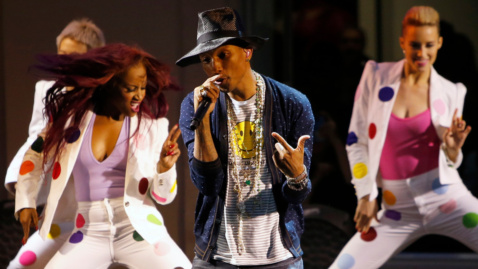 """May 26, 2014. Singer Pharrell Williams performs on stage during a private concert for the exhibition """"GIRL"""" at the Perrotin Gallery in Paris."""