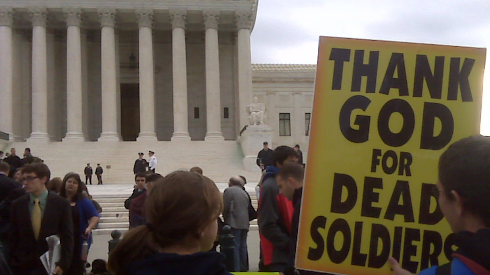 Oct. 6, 2010: Members of Westboro Baptist Church stand outside the U.S. Supreme Court as arguments are heard in the case of whether church members have a right to picket outside a marine's funeral.