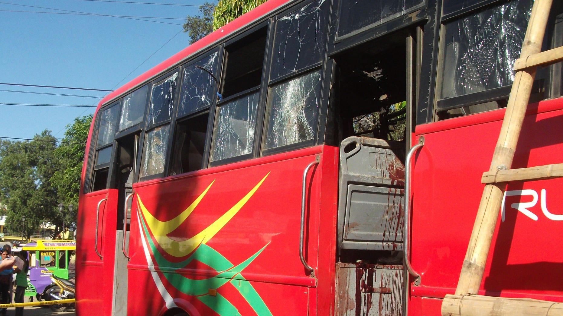 Dec. 10, 2014: Investigators examine the blood-splattered passenger bus