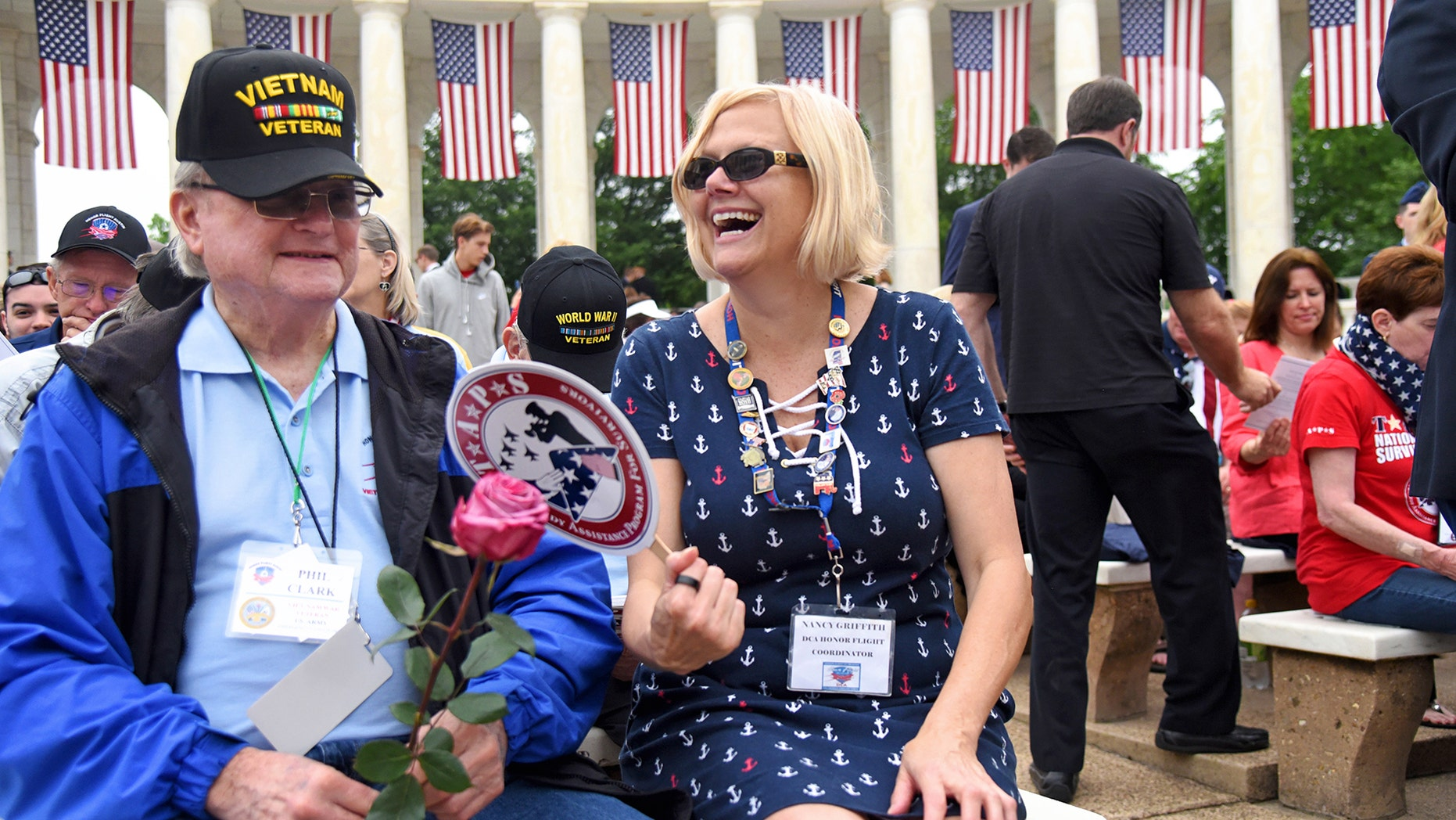 Vietnam veteran Phil Clark shares his war stories with Nancy Griffith, a longtime Honor Flight volunteer and guardian.
