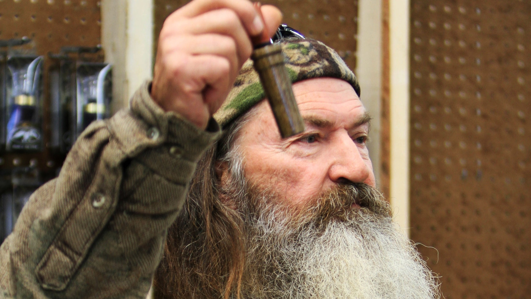 November 7, 2013. Phil Robertson, the Duck Commander, holding the 1 millionth duck call assembled for 2013 at company's warehouse in West Monroe, La.