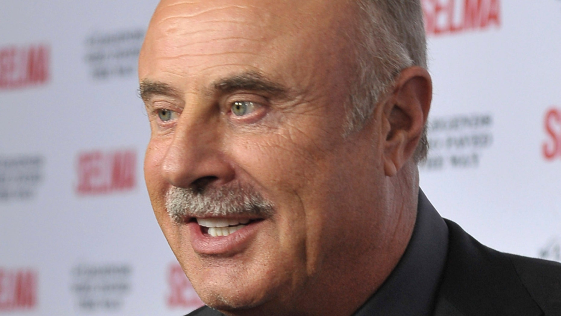 """TV personality Phil McGraw arrives during a gala event for the film """"Selma"""" in Goleta, California December 6, 2014."""