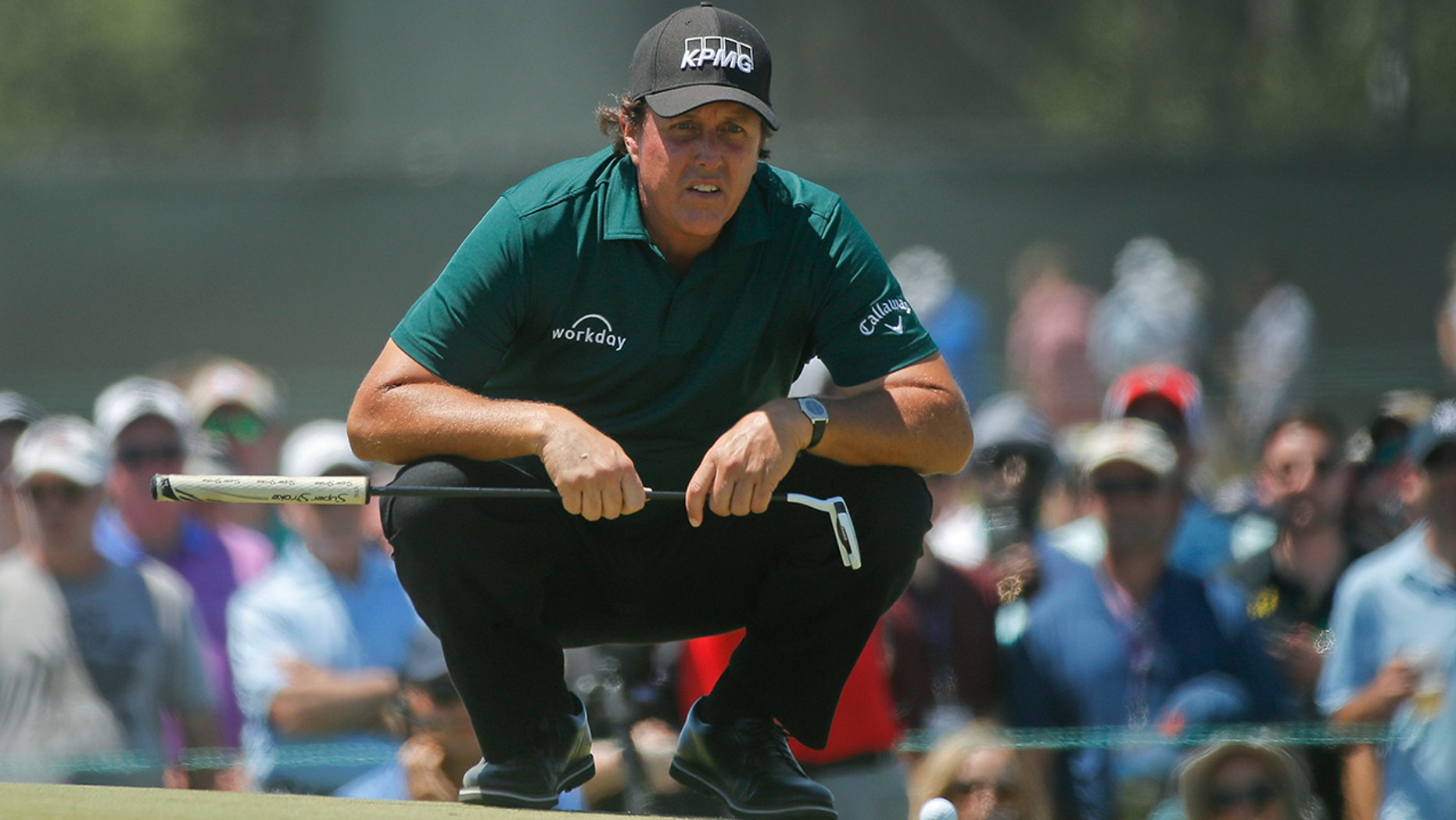 Phil Mickelson lines up a shot on the fourth green during the third round of the U.S. Open Golf Championship, in Southampton, N.Y., June 16, 2018.