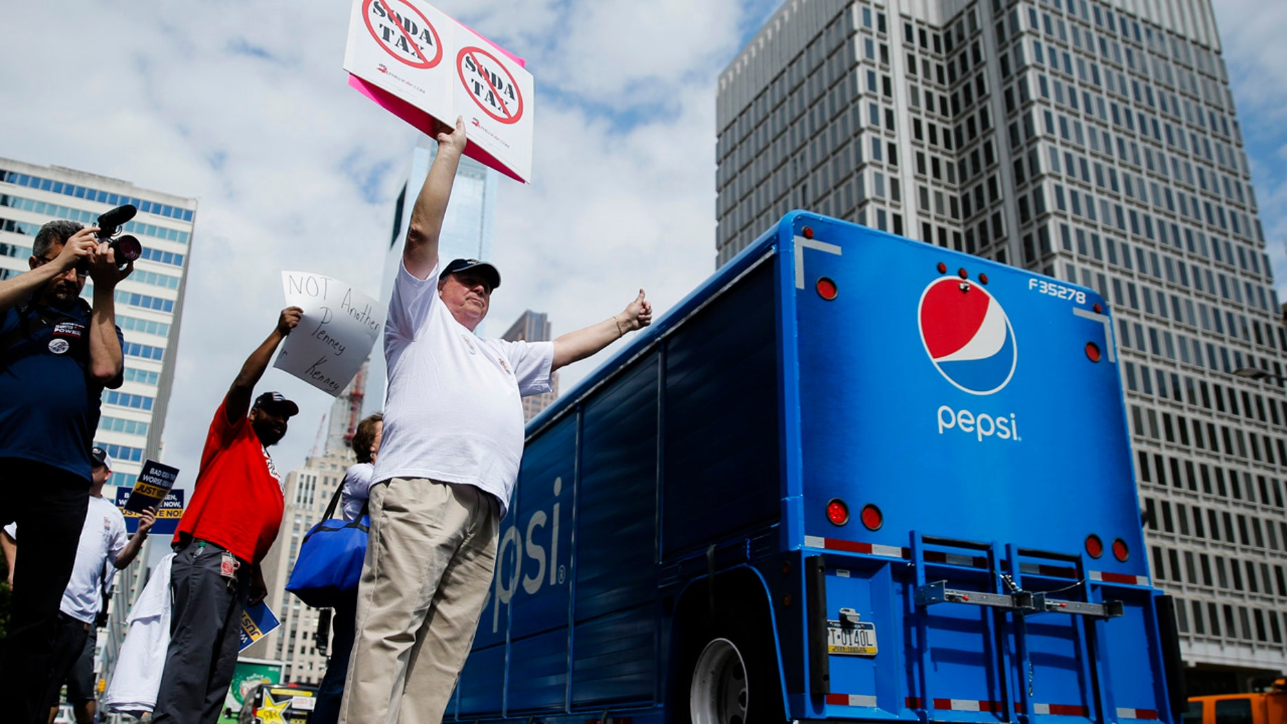 June 8, 2016: Opponents of a proposed sugary drink tax demonstrate outside City Hall in Philadelphia.