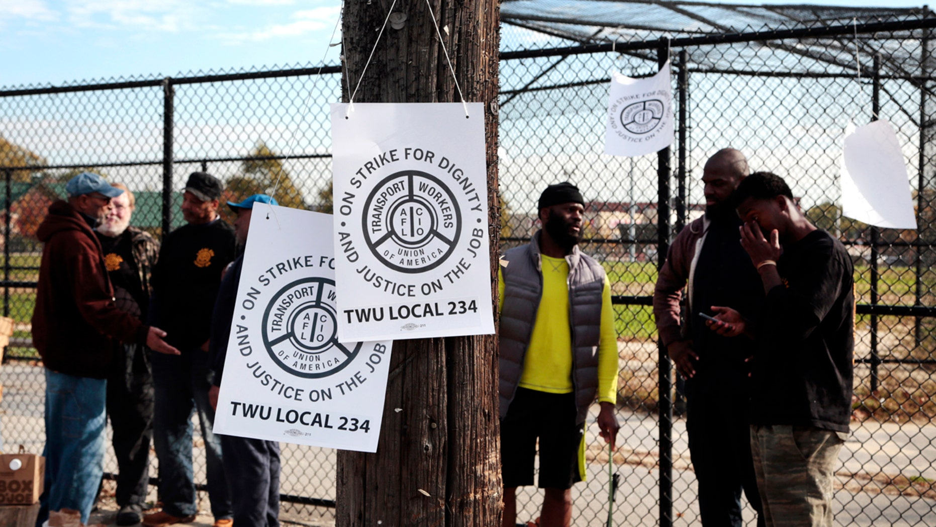 Signs hang on a telephone pole as workers picket across from the Callowhill SEPTA Depot Tuesday, Nov. 1, 2016, in Philadelphia.