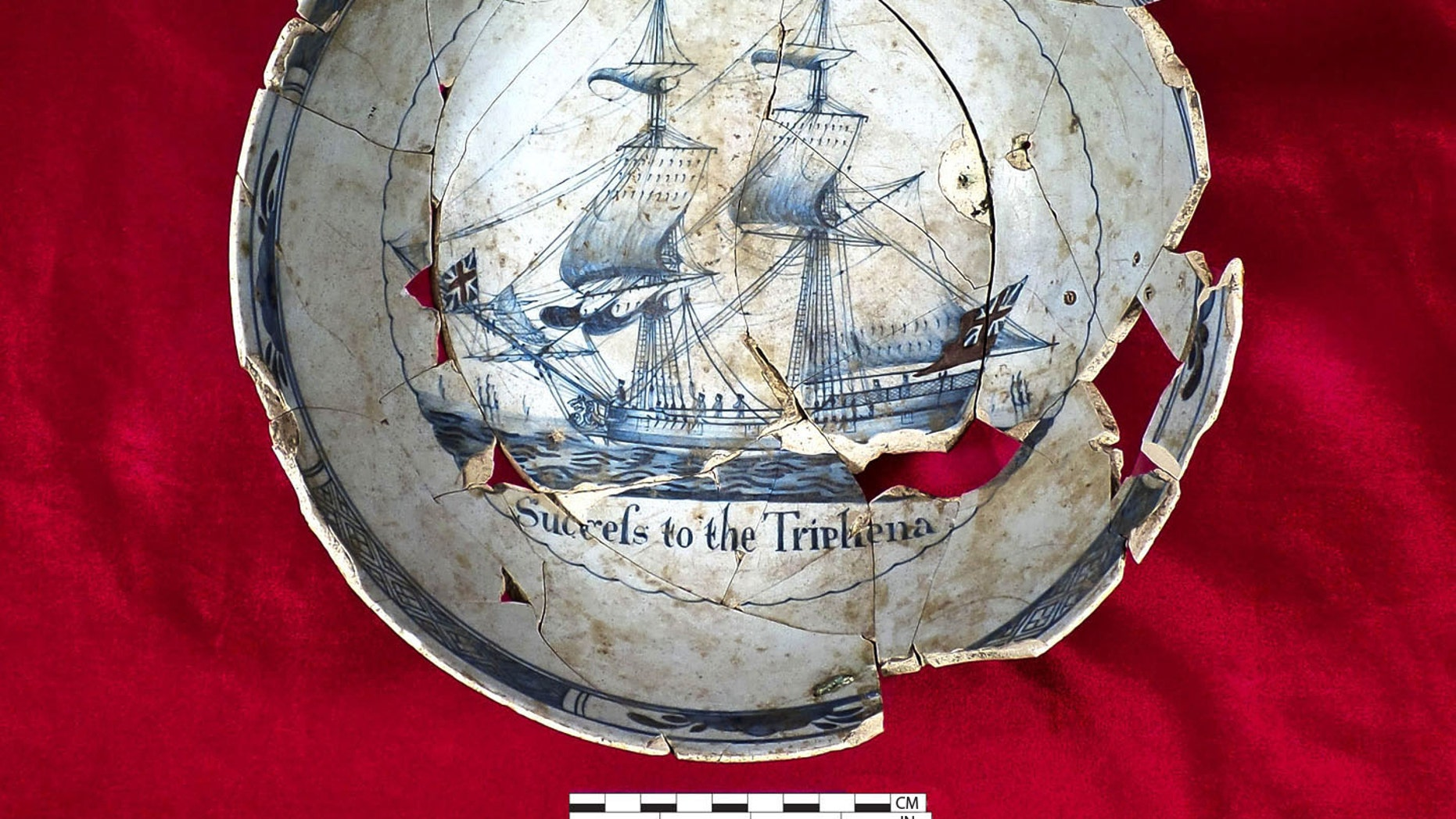 """Punch bowl made out of tin glazed earthenware that has the message,""""Success to the Tryphena"""" inscribed on the inside. (Commonwealth Heritage Group)"""