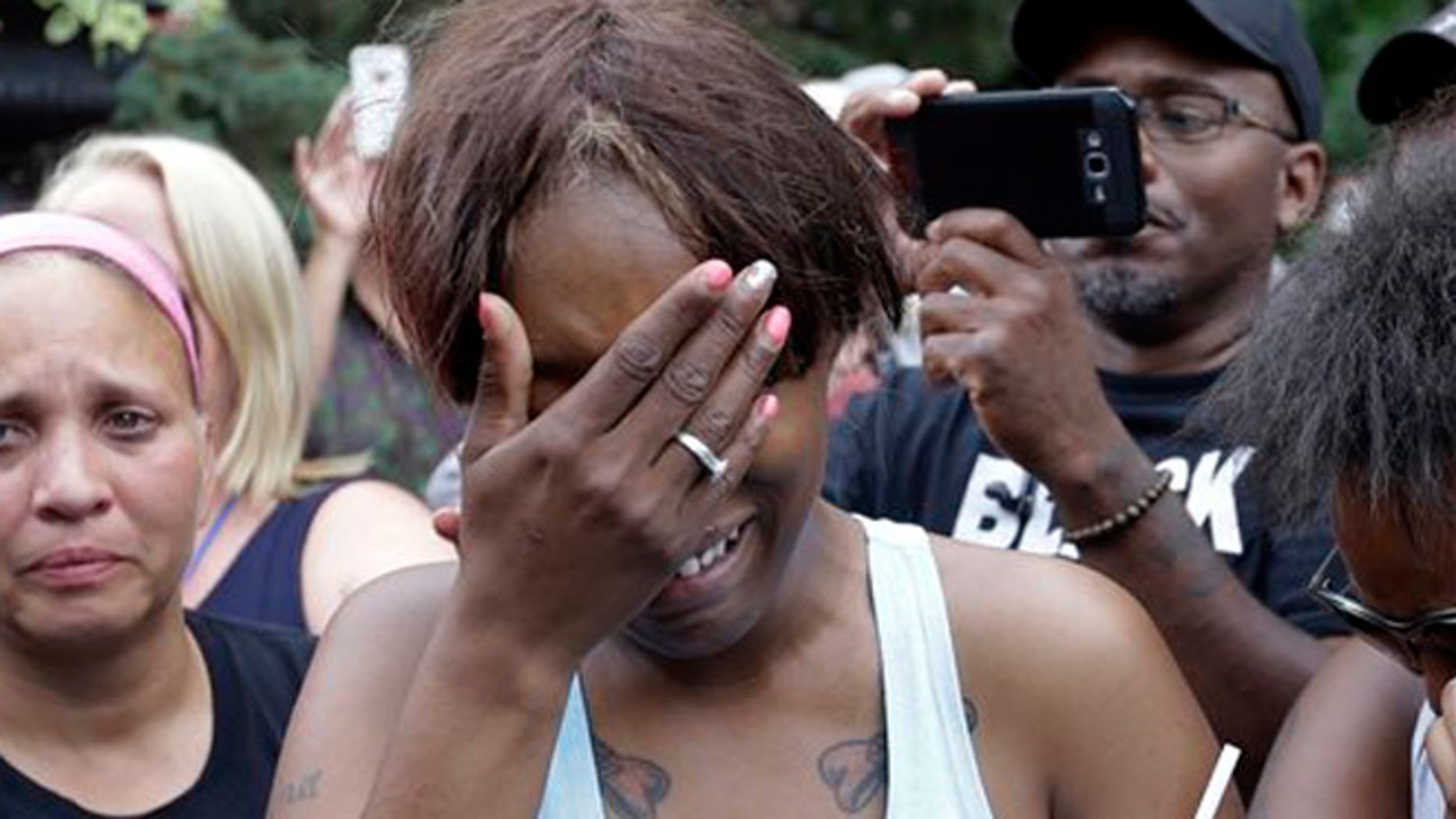 Diamond Reynolds, the girlfriend of Philando Castile of St. Paul, cries outside the governor's residence in St. Paul, Minn., on Thursday, July 7, 2016.  Castile was shot and killed after a traffic stop by police in Falcon Heights, Wednesday night. A video shot by Reynolds of the shooting  went viral.  (AP Photo/Jim Mone)
