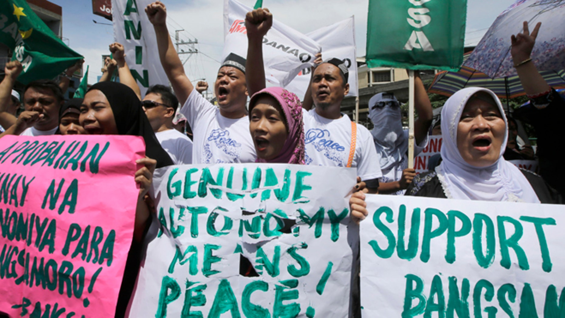 Sept. 10, 2014: Filipino Muslims shout slogans during a rally near the Presidential Palace in support of the Bangsamoro Basic Law draft that was formally submitted by Philippine President Benigno Aquino III to both houses of Congress in Manila, Philippines.