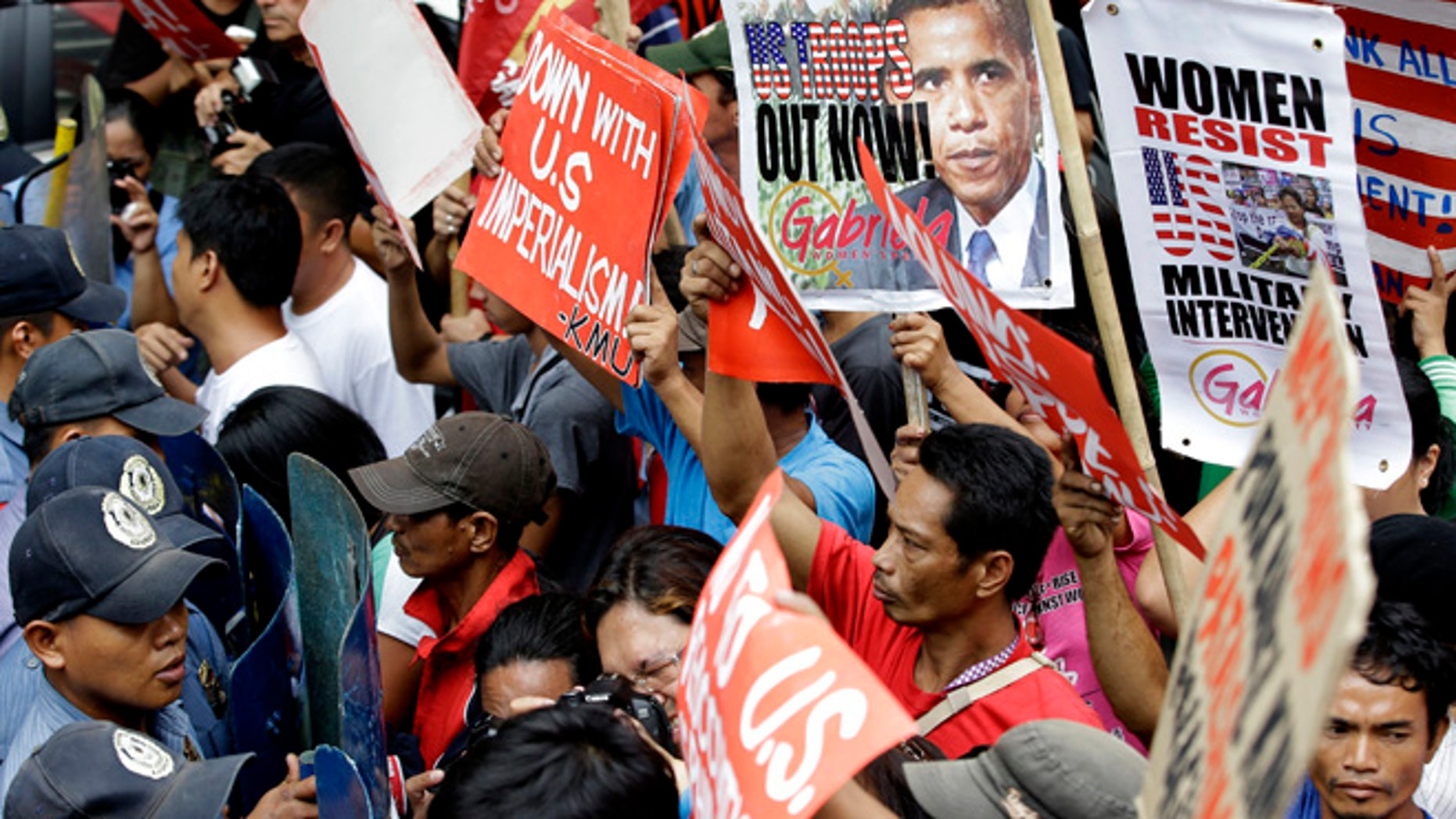 July 4, 2014: Protesters are blocked by police as they try to march closer to the U.S. Embassy to mark Philippine-American Friendship day.