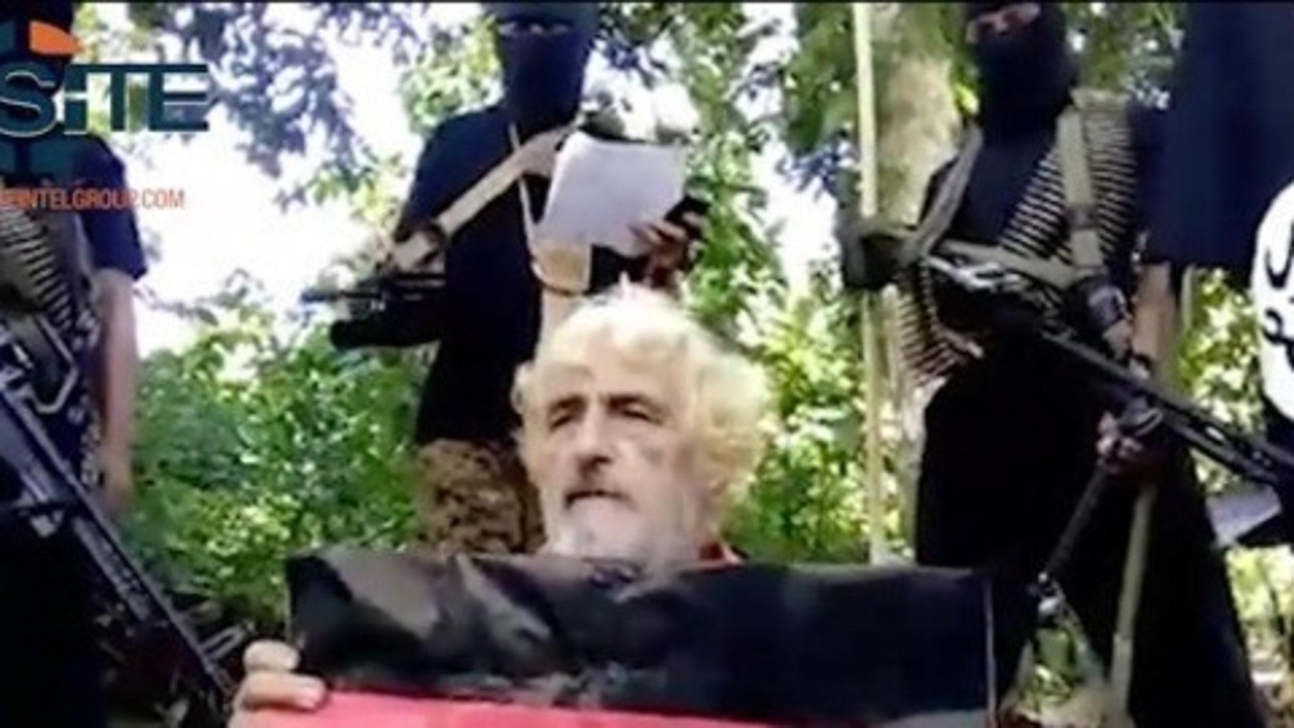 German hostage Jurgen Gustav Kantner kneels before his Islamic militant captors at an undisclosed location.