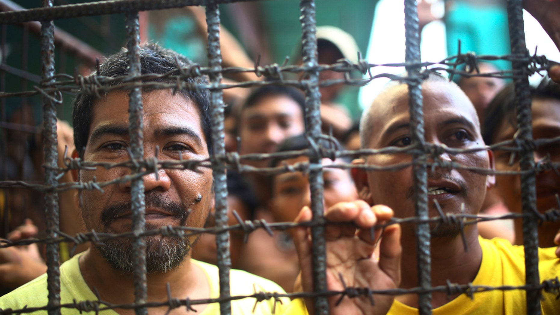 Filipino inmates remain in their cell at the North Cotabato District Jail in Kidapawan city, Cotabato Province, southern Philippines, after a massive jailbreak Wednesday, Jan. 4, 2017.