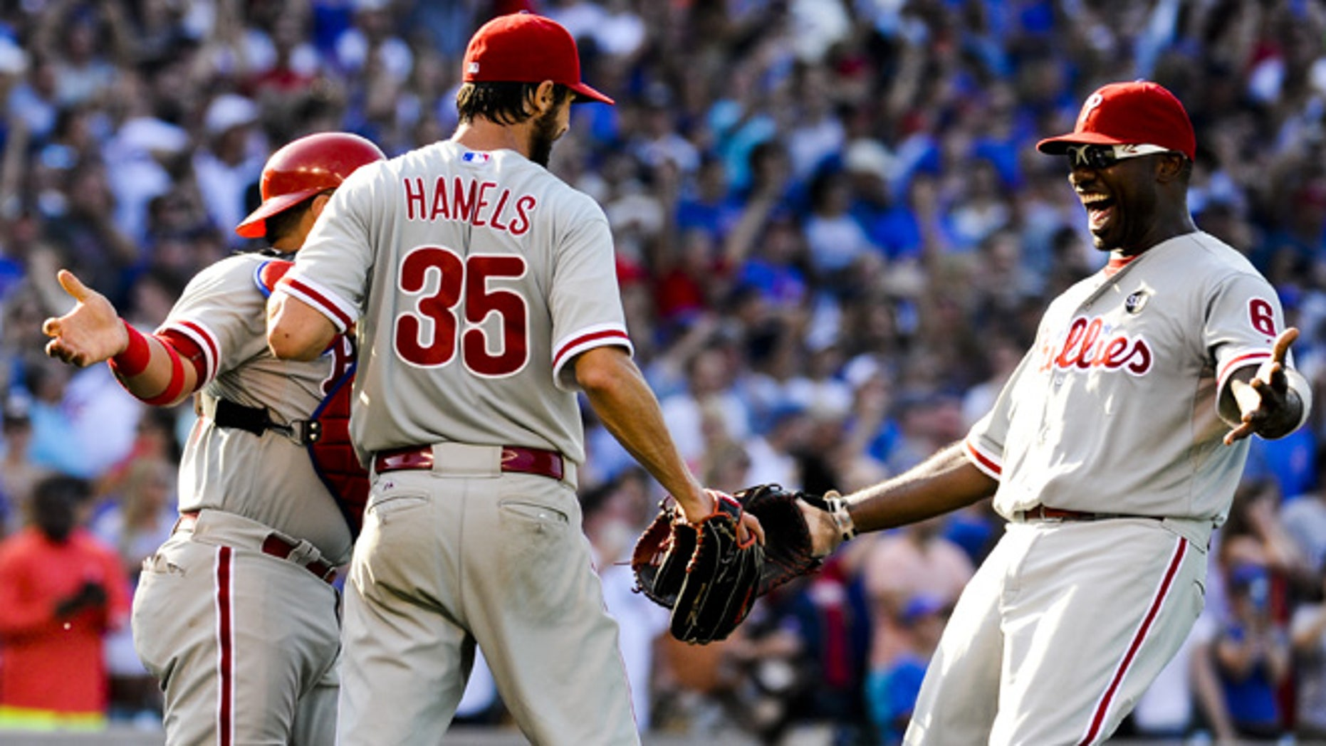 July 25, 2015: Philadelphia Phillies' starting pitcher Cole Hamels (35) is hugged by Phillies' catcher Carlos Ruiz, left, and first baseman Ryan Howard after he pitched a no-hitter during a baseball game against the Chicago Cubs in Chicago. (AP)