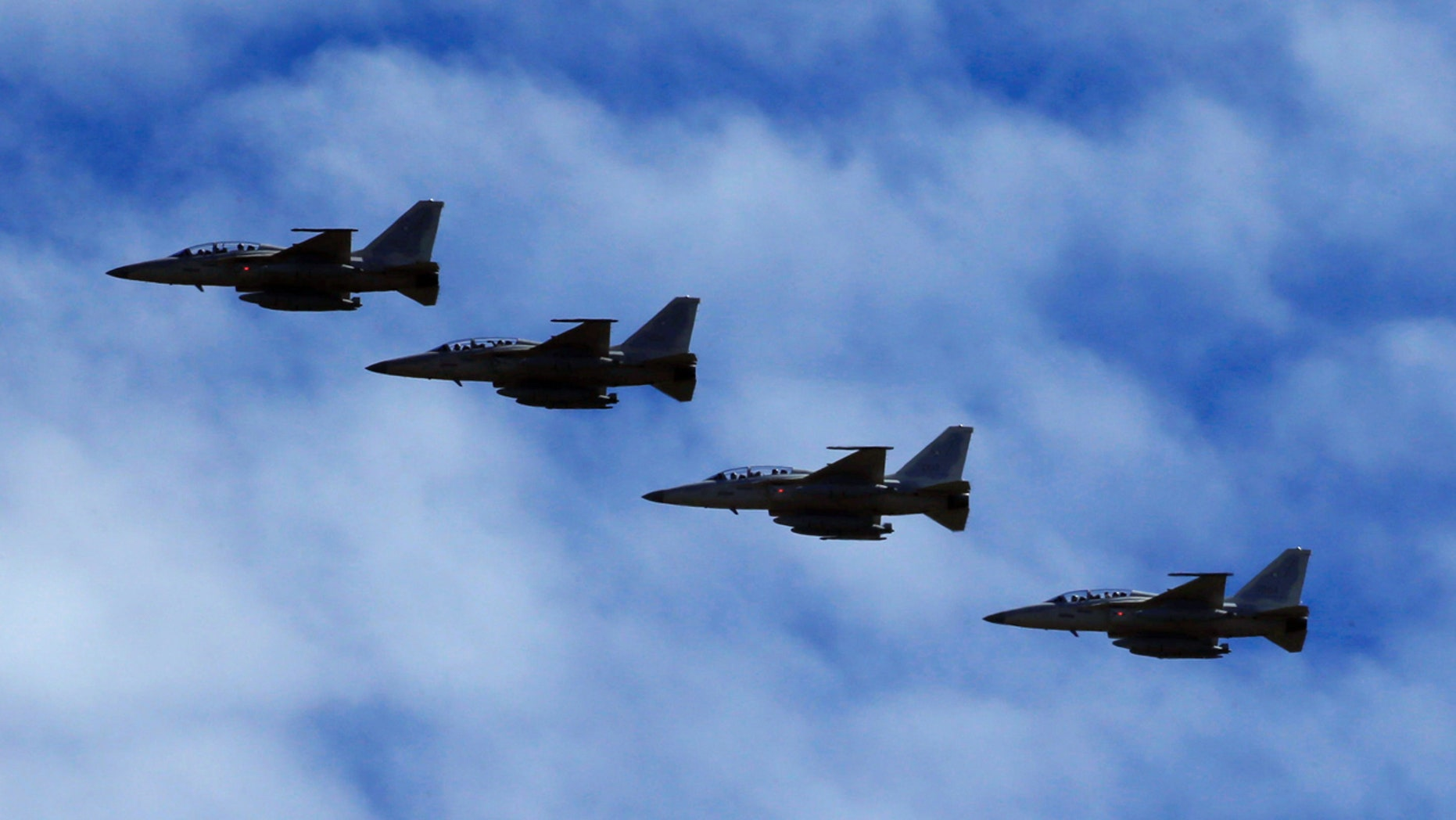 FA-50 fighter jets, newly purchased from South Korea, are escorted by fighter jets in the sky upon arrival in Clark air base, Angeles city, Pampanga province, north of Manila, Philippines December 1, 2016.  REUTERS/Romeo Ranoco - RTSU4O9