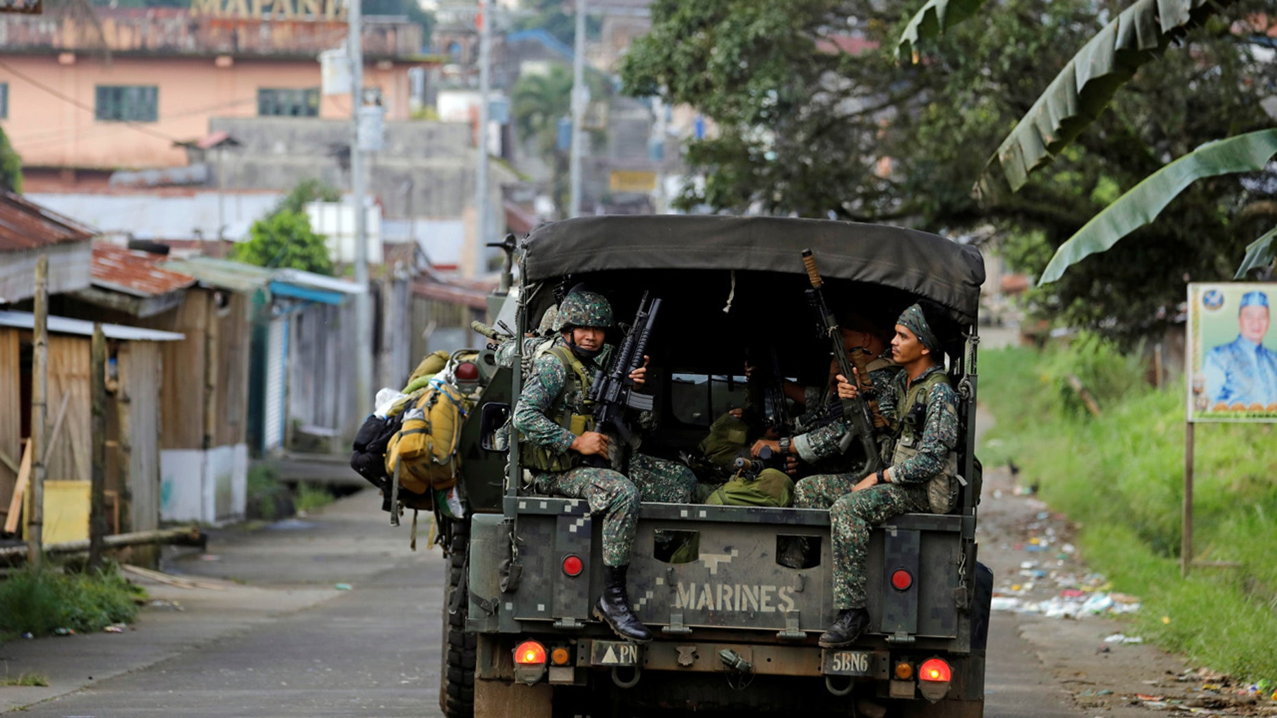Philippine Marines ride in a military vehicle as they advance their position in Marawi City, southern Philippines May 30, 2017. REUTERS/Erik De Castro - RTX3864E