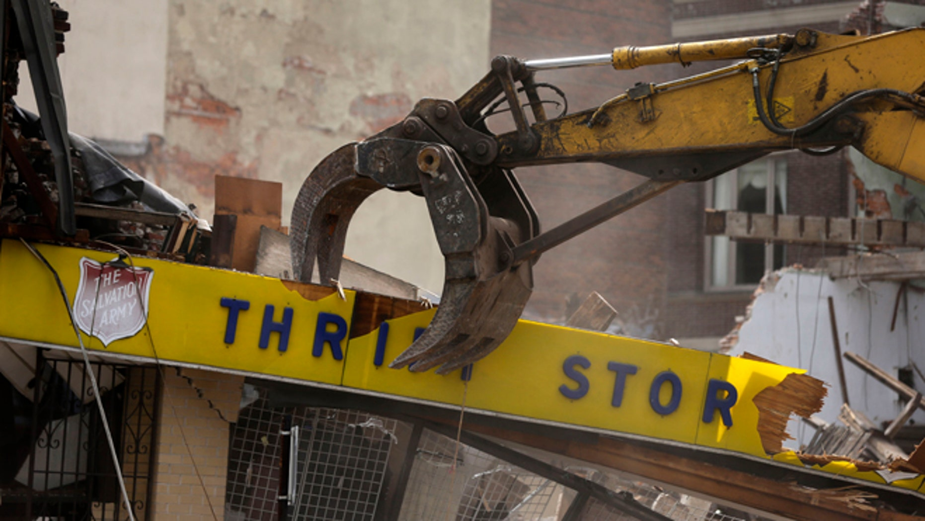 June 6, 2013: A Salvation Army Thrift store is demolished in the aftermath of a building collaps in Philadelphia.