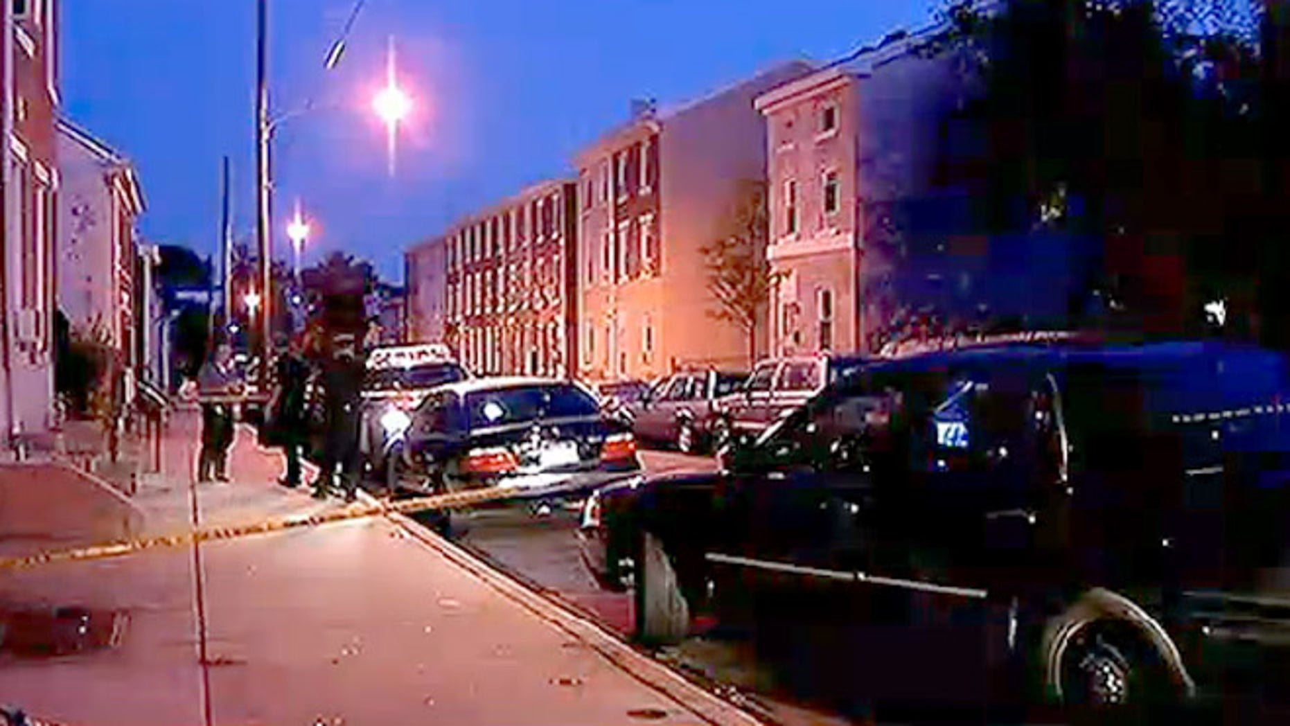 Police investigate the scene where three people suffered gunshot wounds during an early morning shooting in Norristown, Pa.