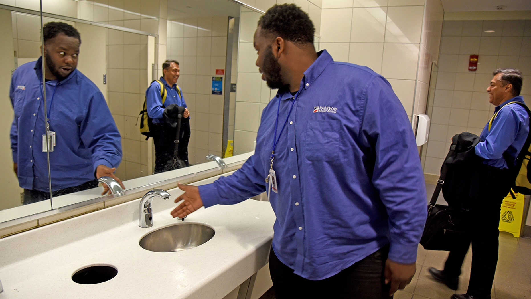 A worker with airport services checks the water pressure at Philadelphia International Airport following the water main breakage on Monday afternoon.