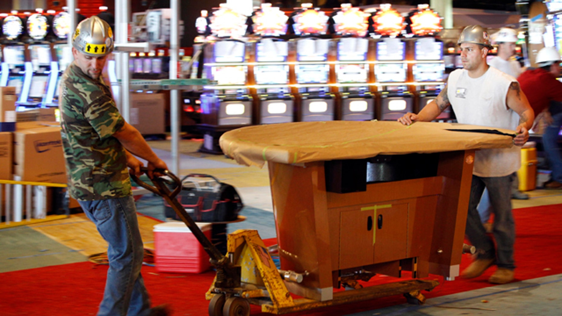 FILE - In this  Aug. 30, 2010 file photo, workmen move a table game at the SugarHouse Casino in Philadelphia, Six years after the state Legislature legalized gambling, Philadelphia on Thursday, Sept. 23, 2010 is set to become the largest U.S. city with a casino.  (AP Photo/Matt Rourke, File)