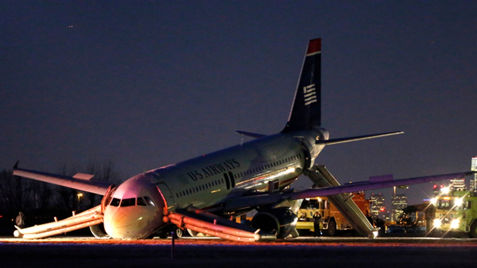 Mar. 13, 2014: A damaged US Airways jet lies at the end of a runway at the Philadelphia International Airport in Philadelphia.