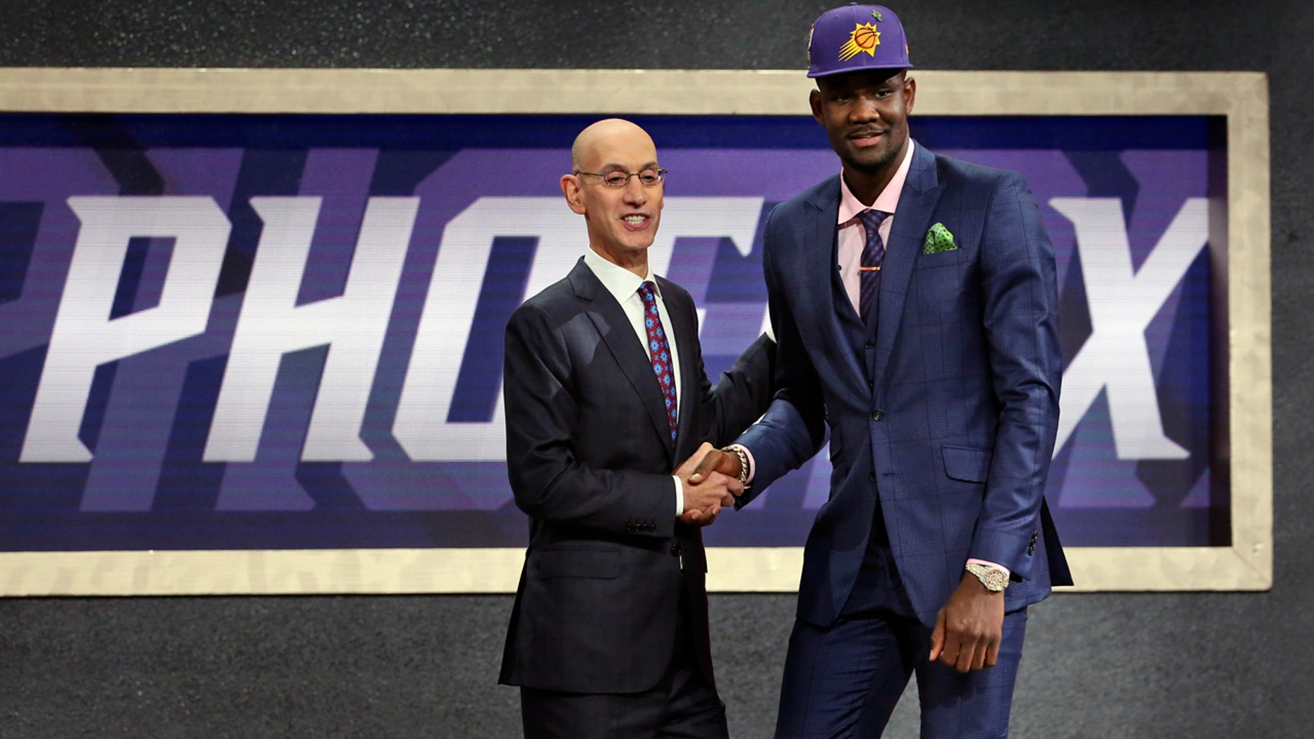 Arizona's Deandre Ayton, right, poses with NBA Commissioner Adam Silver after he was picked first overall by the Phoenix Suns during the NBA Draft at Barclays Center in Brooklyn, N.Y.