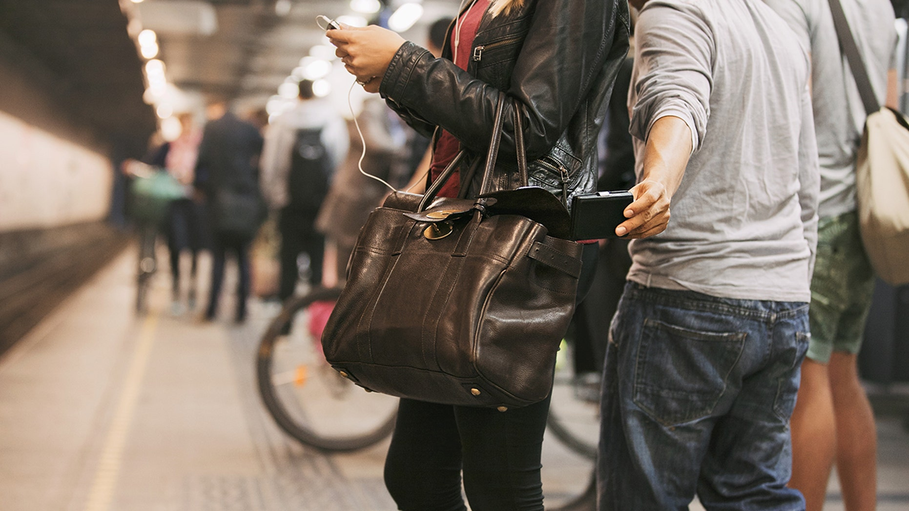 Some scammers all all-too-eager to separate distracted tourists from their belongings.